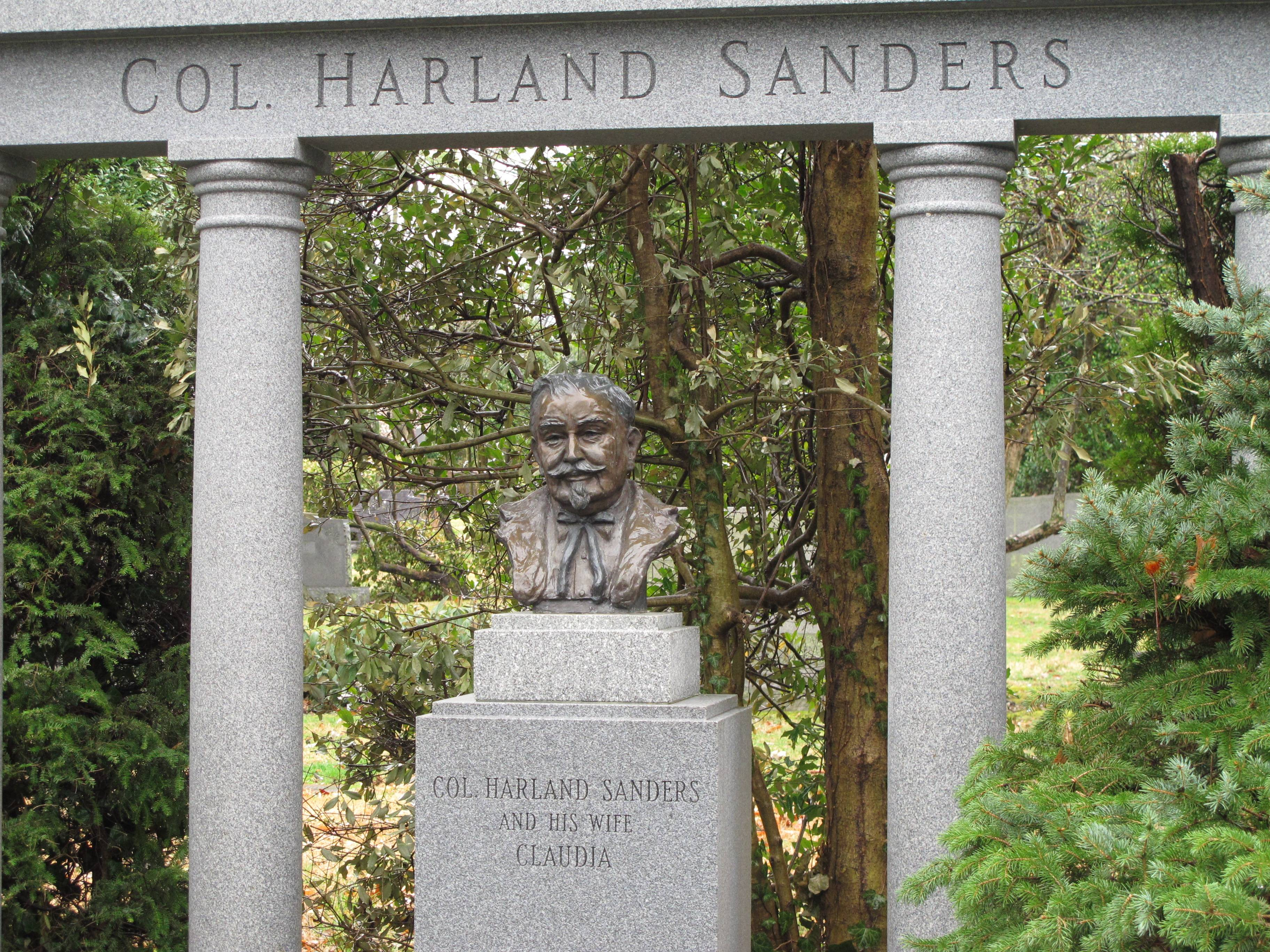 This bust of Colonel Harland Sanders marks the KFC founder's grave at Cave Hill Cemetery in Louisville, Ky. The nearly 300-acre cemetery features ornate marble and granite monuments and is shaded by a wide variety of trees that loom over the rolling grounds.
