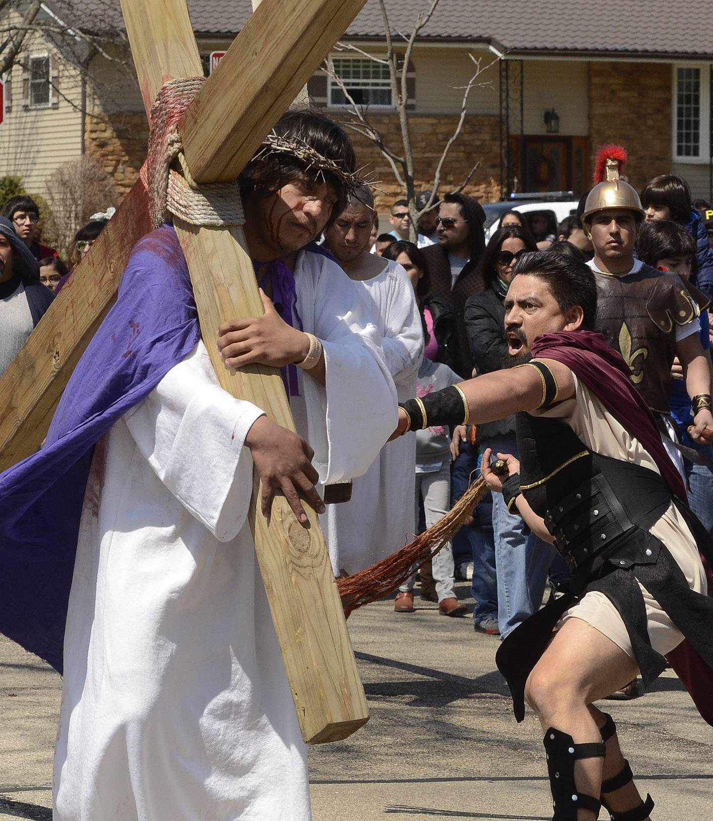 Rubin Callajo, playing the role of Jesus Christ, is whipped by Juvenal Cervantes, acting as a Roman soldier, during a living Stations of the Cross re-enactment on Good Friday by the Mision San Juan Diego in Arlington Heights.