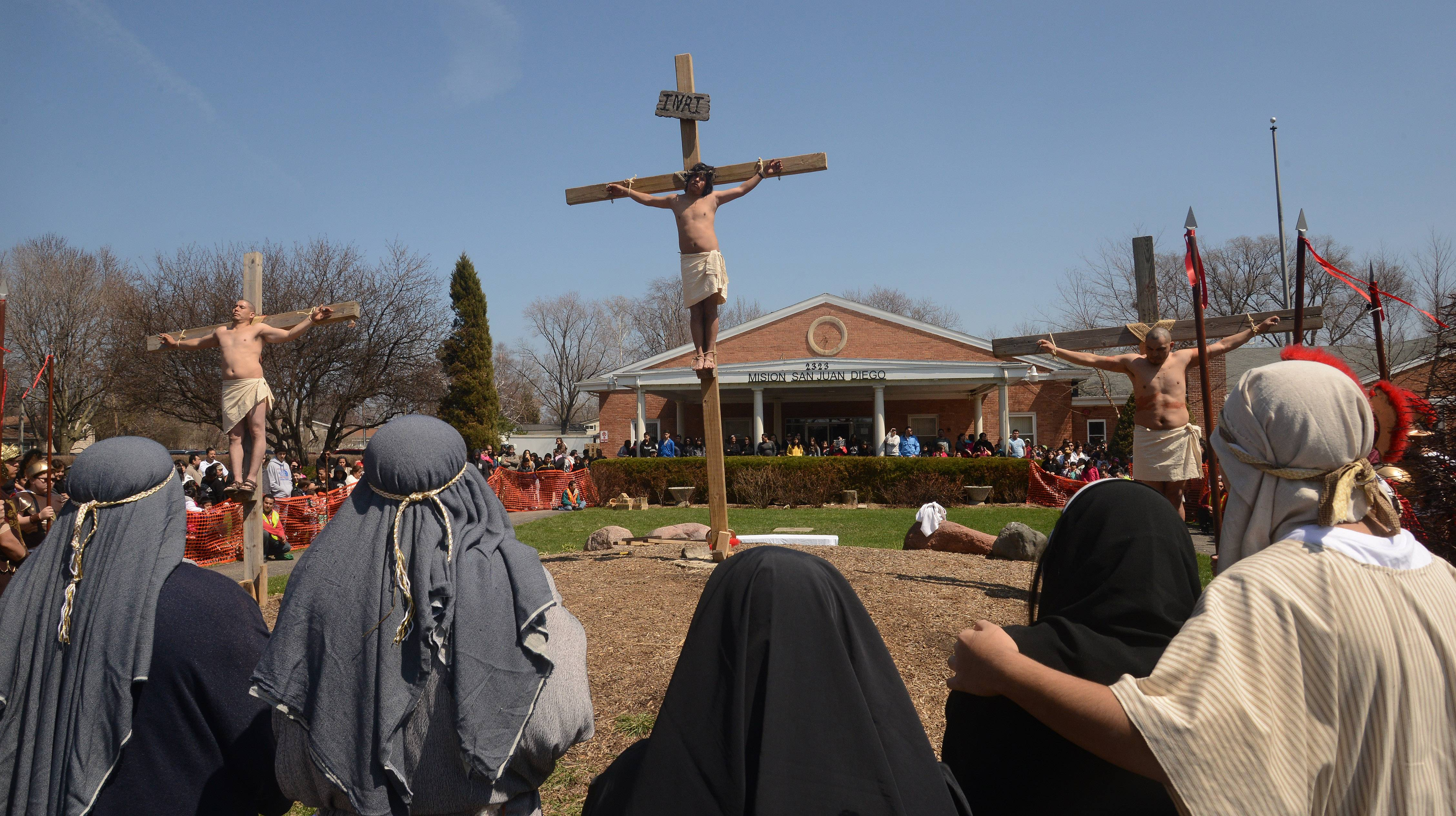 The 12th Station of the Cross, signifying Jesus' death, is performed during a Good Friday re-enactment at Mision San Juan Diego in Arlington Heights.