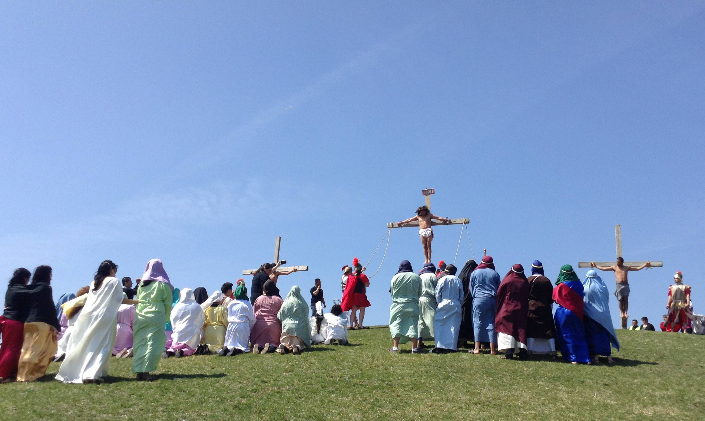 Isidro Zuniga, center, portrays Jesus in Saint Ansgar Catholic Church's staging of Via Crucis, or Way of the Cross, in Hanover Park Friday.