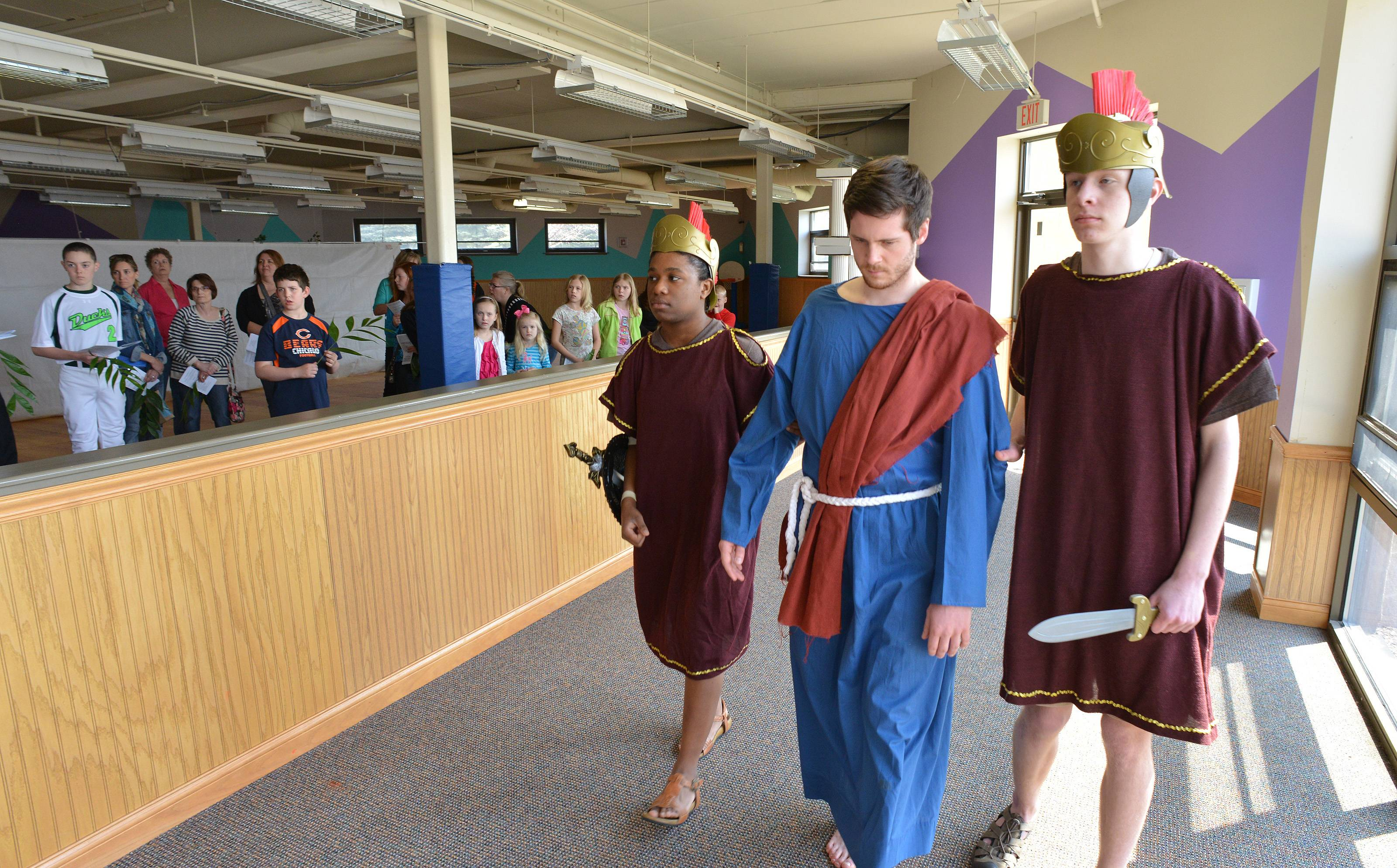 After his arrest, Jesus is led away for trial by two Roman Guards. Left to right, the actors are Taya Finch, Conor Hughes and Nick Duesing.