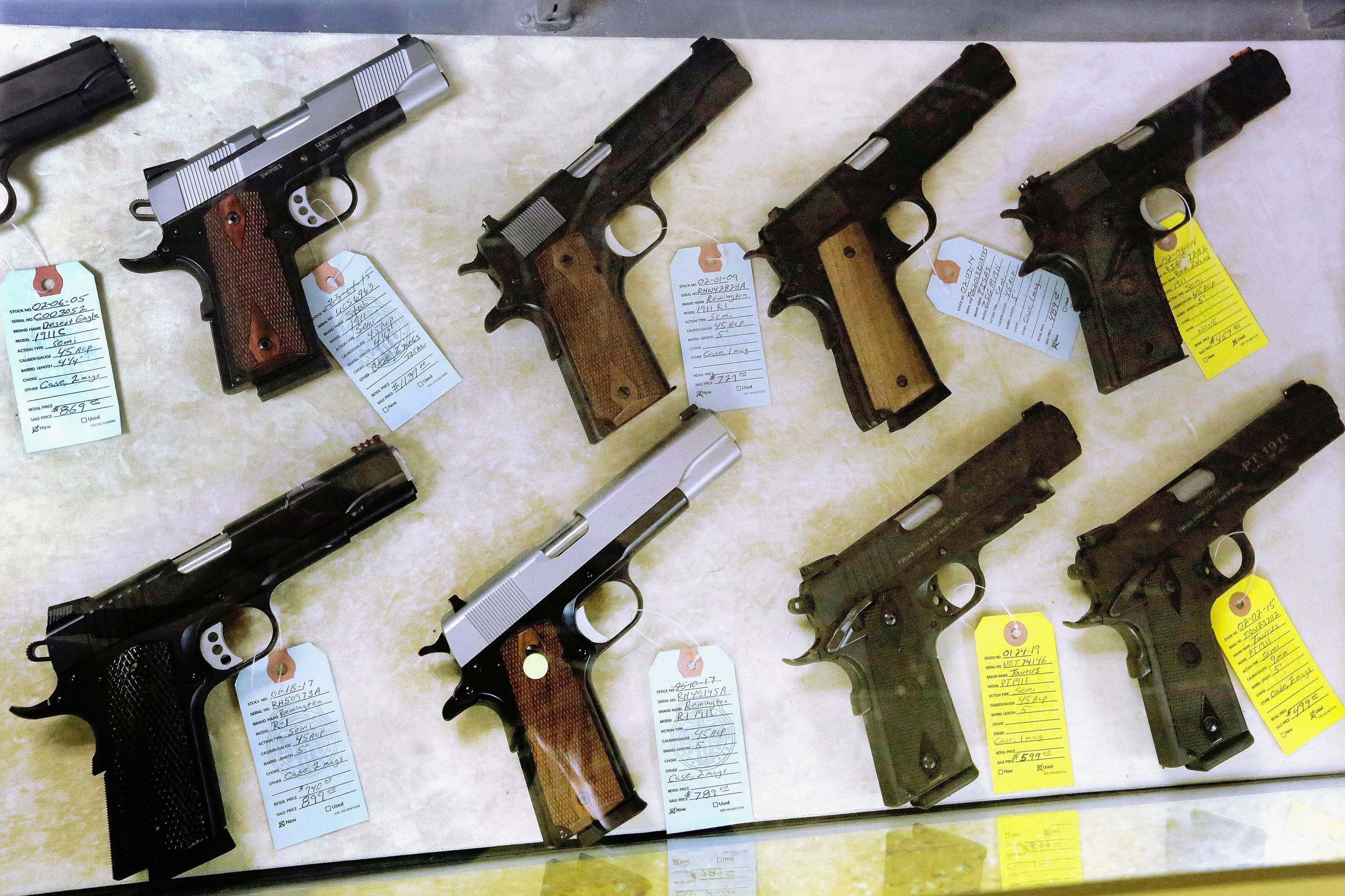Semiautomatic handguns on display for purchase at Capitol City Arms Supply in Springfield, Ill.