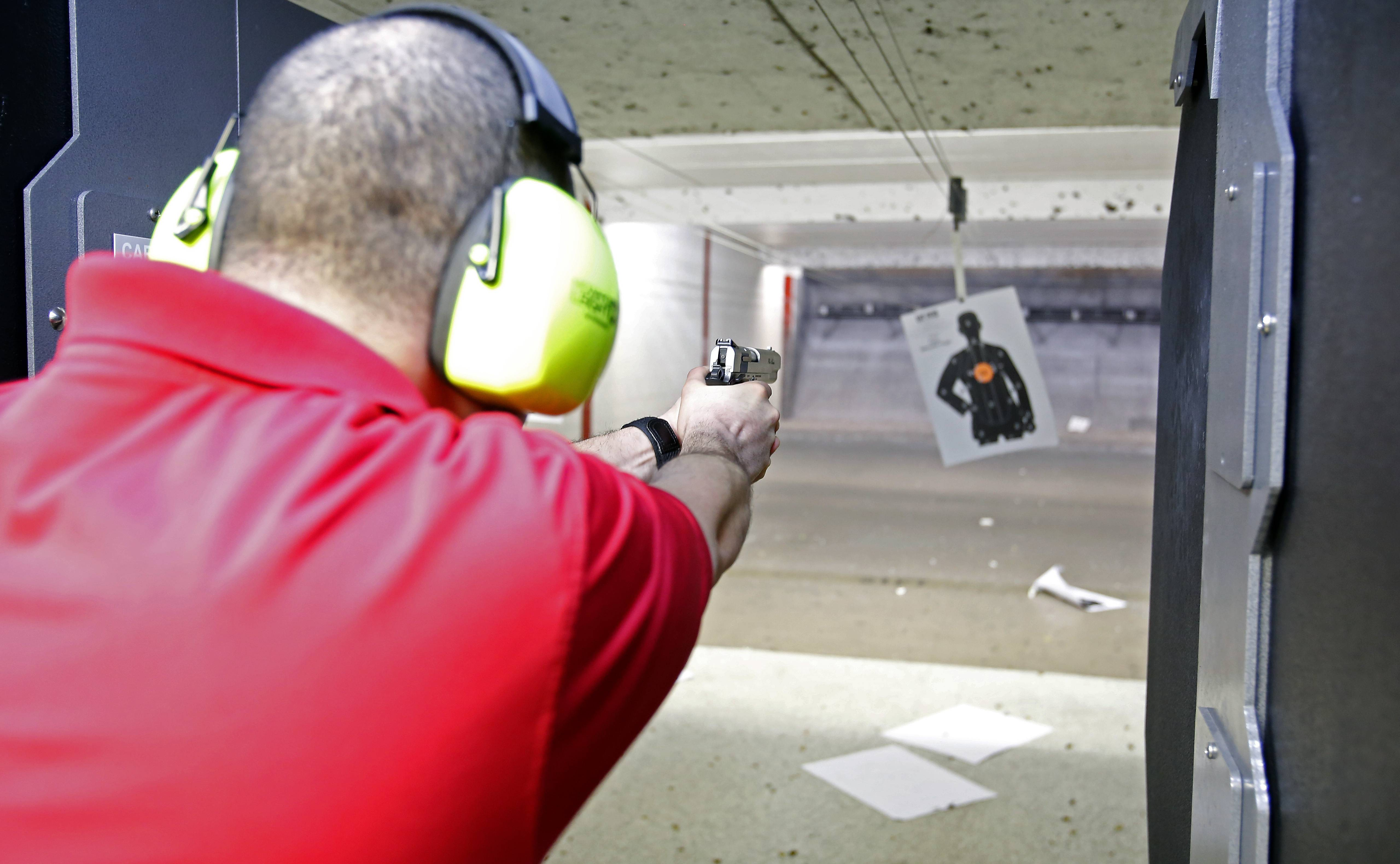 Noel Garcia, an instructor at GAT Guns in East Dundee. practices at the company's range in East Dundee. Local ranges have seen a significant increase in use as people seek training required for concealed carry permits.