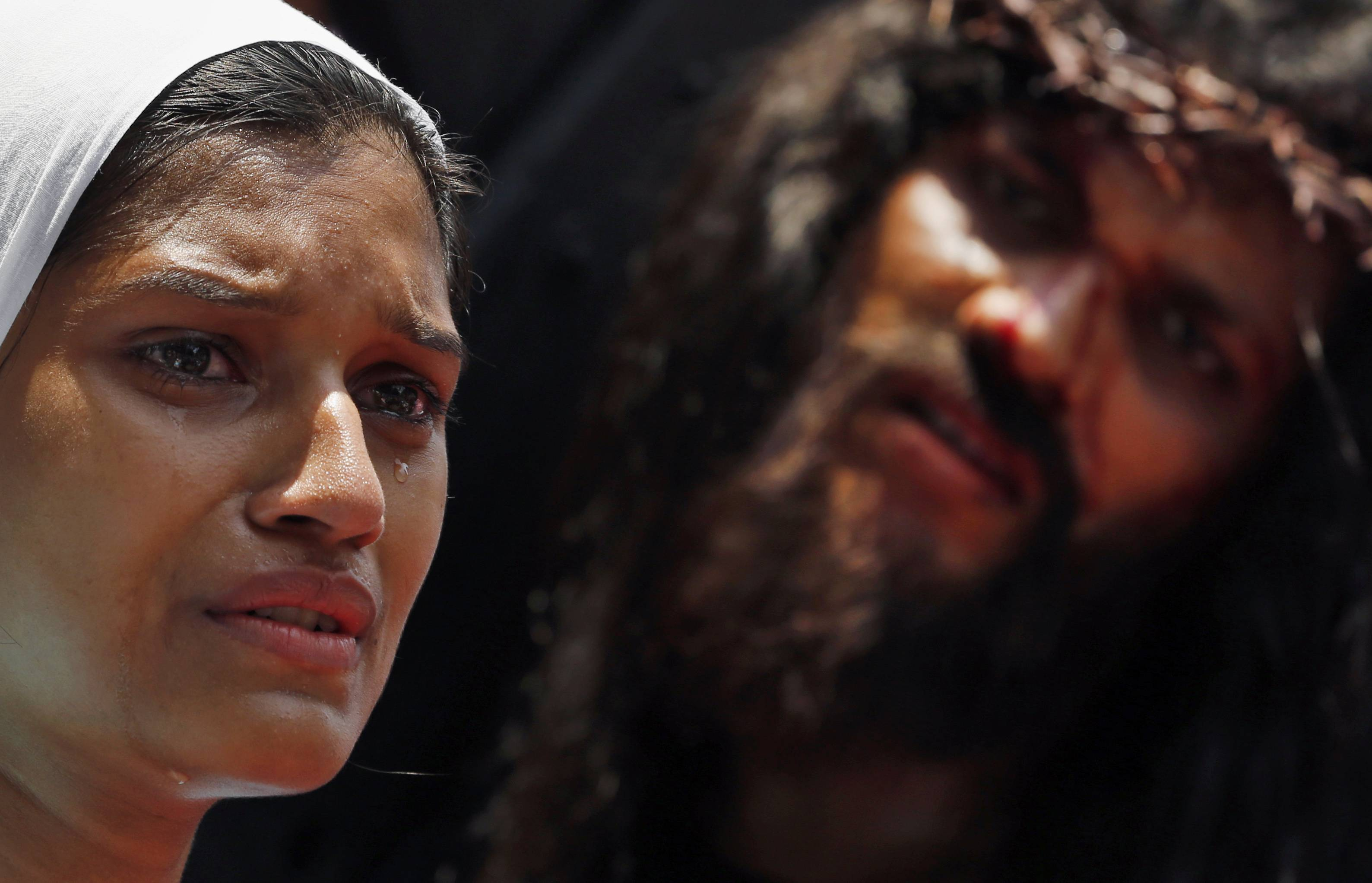 Indian Christian devotees re-enact the crucifixion of Jesus Christ to mark Good Friday in Mumbai, India.