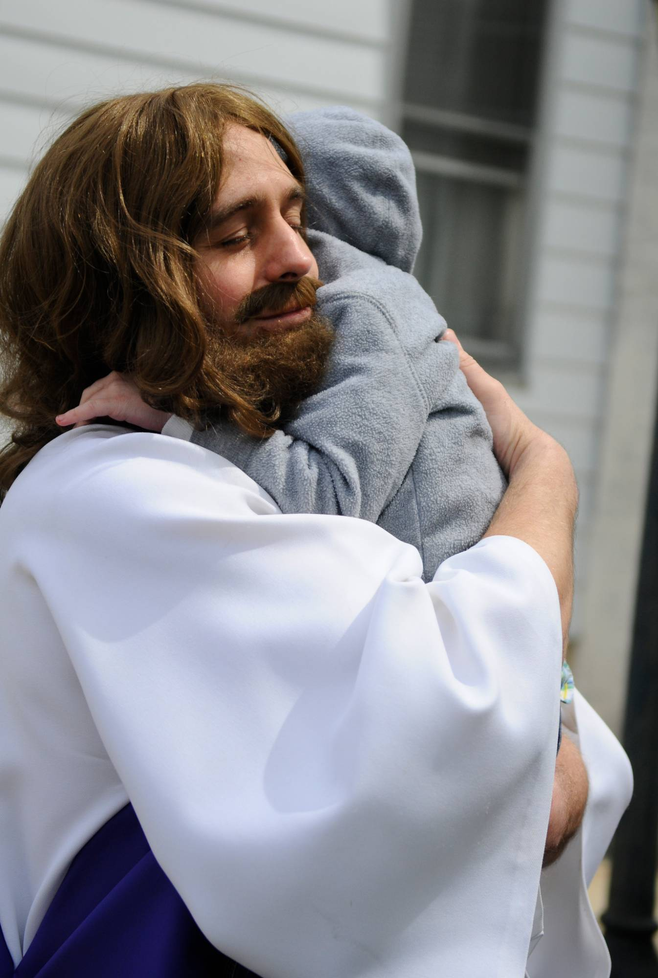 Jeff Nemeth, Frackville, Pa., hugs his son Jeffrey Nemeth Jr., after portraying Jesus through the streets of Gordon during the 36th annual Trek of the Cross in Gordon, Pa.