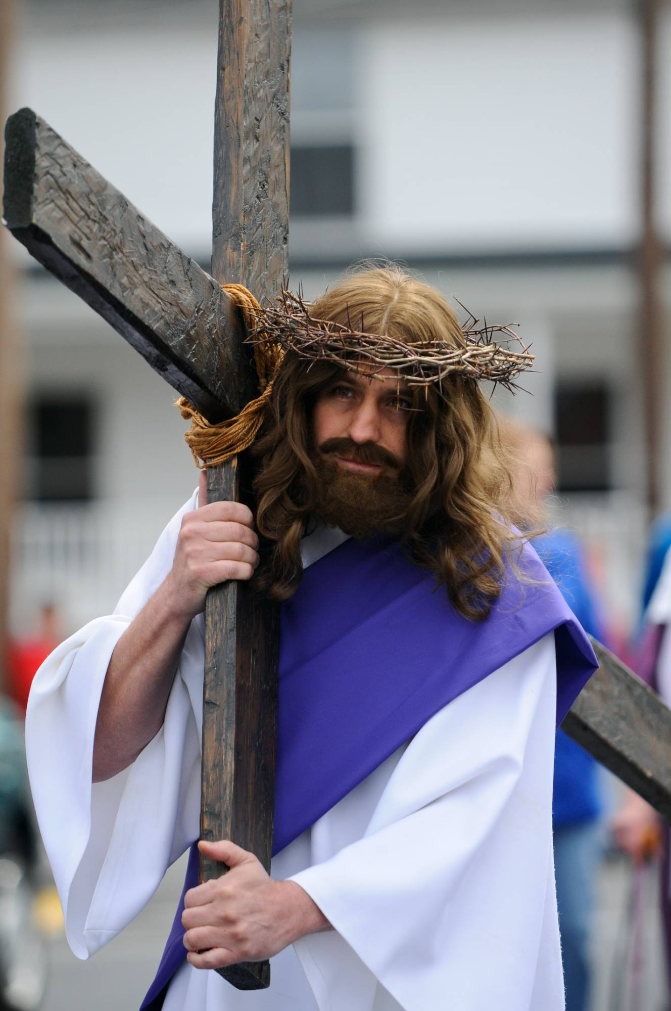 Jeff Nemeth, Frackville, Pa., carries the cross as he portrays Jesus during the 36th annual Trek of the Cross through the streets of Gordon, Pa.