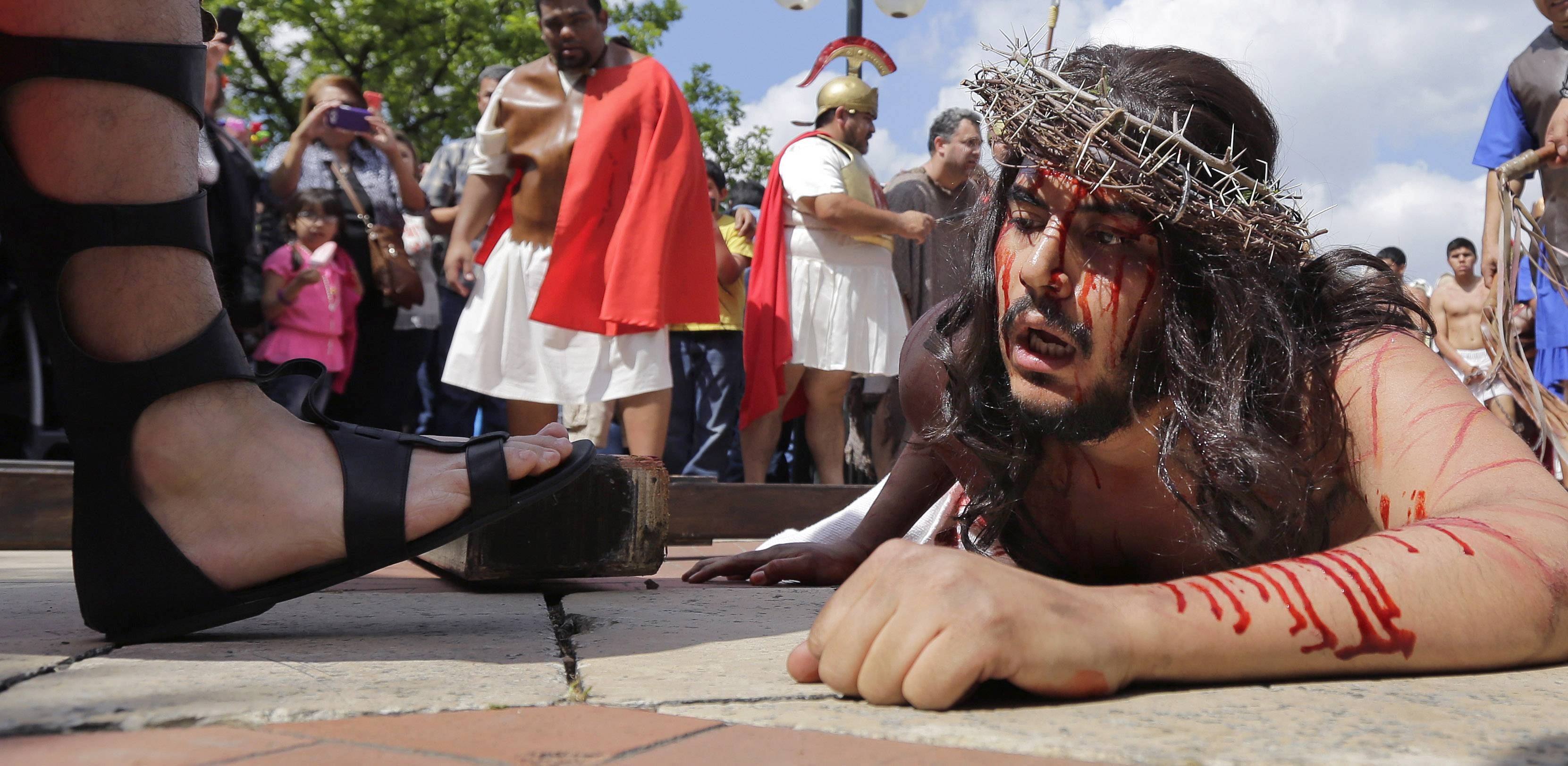 Jose Nina plays the part of Jesus in a passion play and procession, Friday, April 18, 2014, in downtown San Antonio.