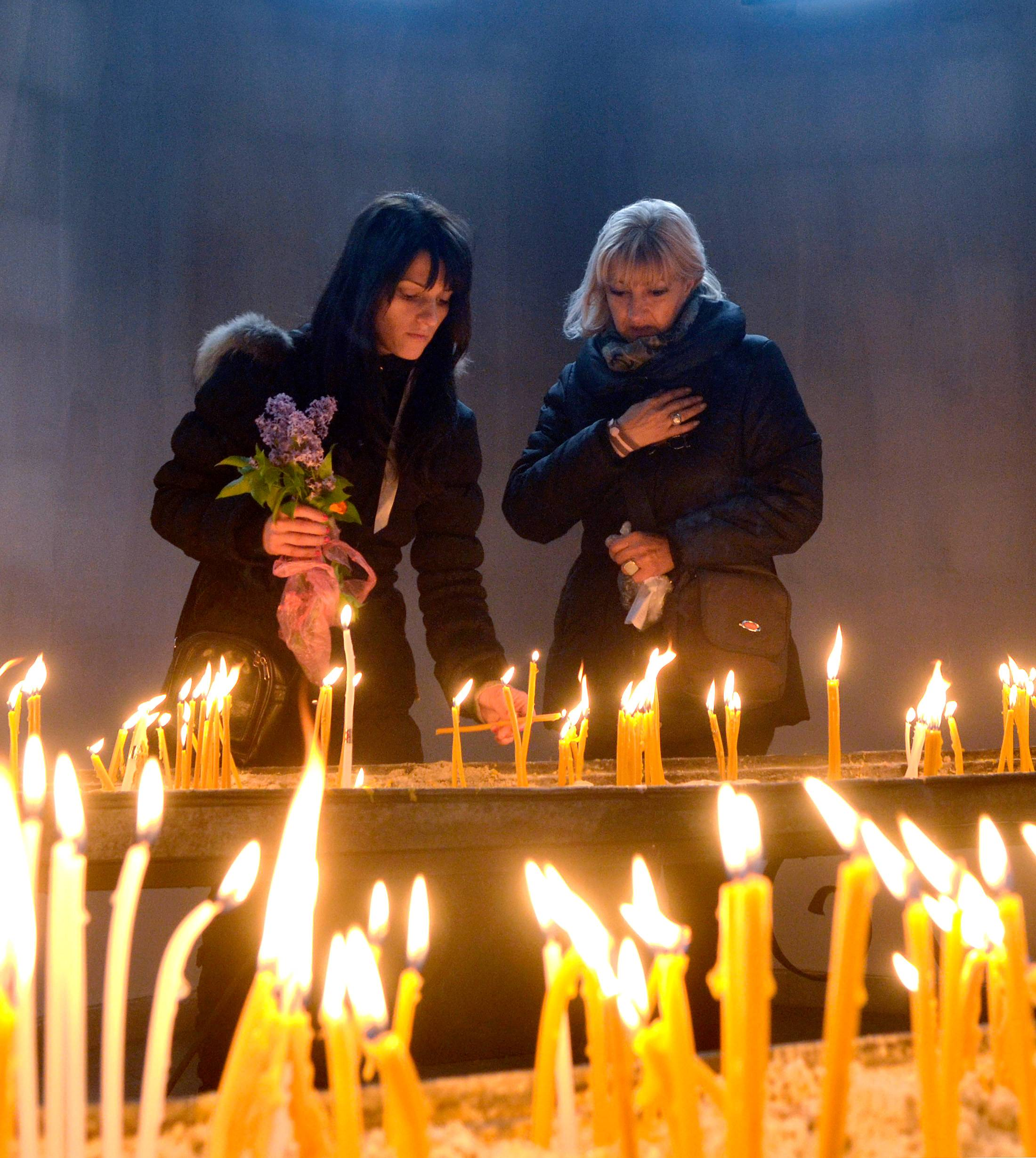 Women light candles on Good Friday, at St Clement Christian Orthodox church in Skopje, Macedonia.