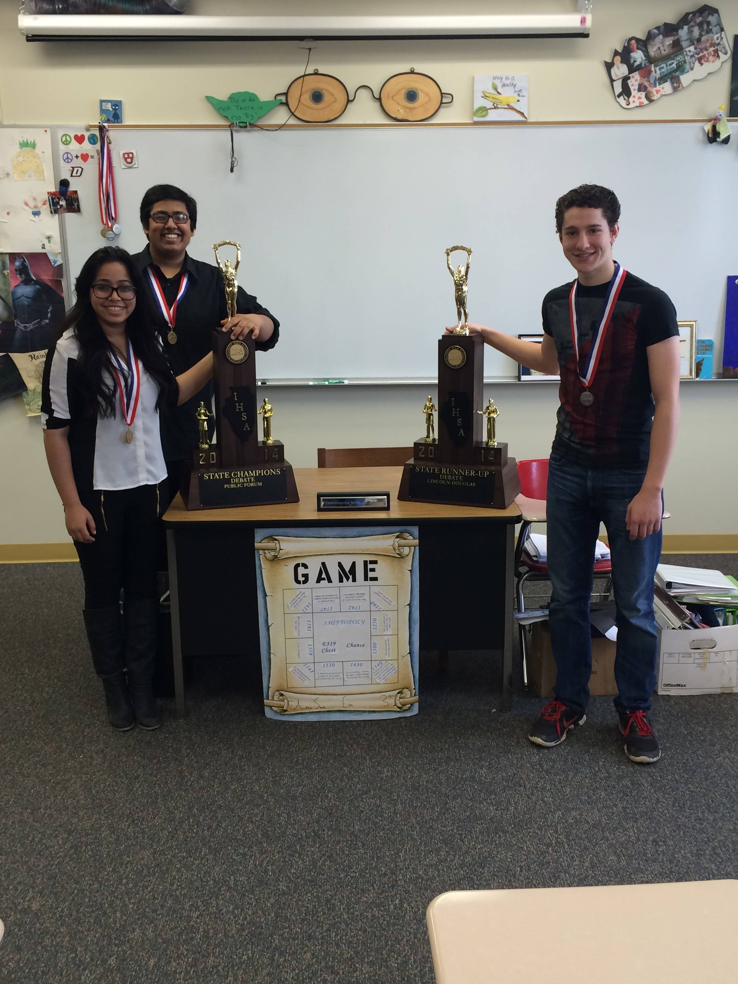A few members of Schaumburg High School's state champion debate team pose with their state trophies and medals. From left are sophomores Jessica D'Souza and Raza Haque and junior Nathaniel Leonhardt, who was named captain of the All-State Debate Team.