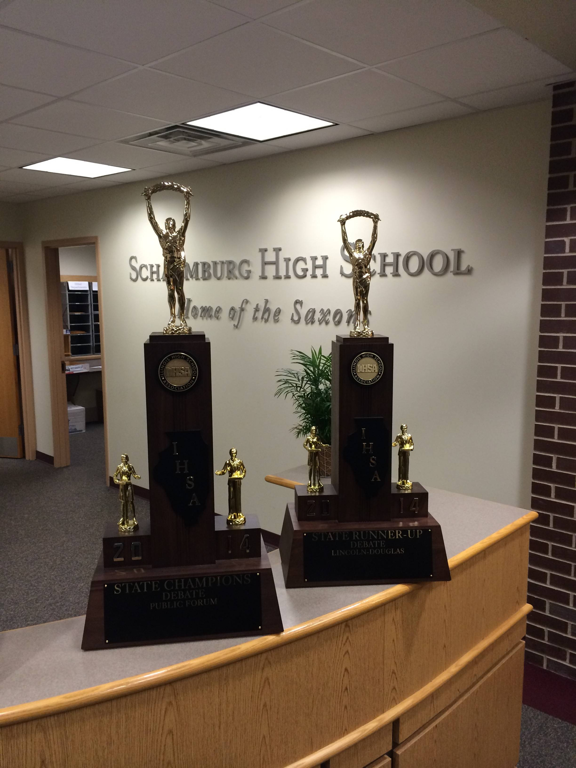 These are the trophies Schaumburg High School won in state debate.