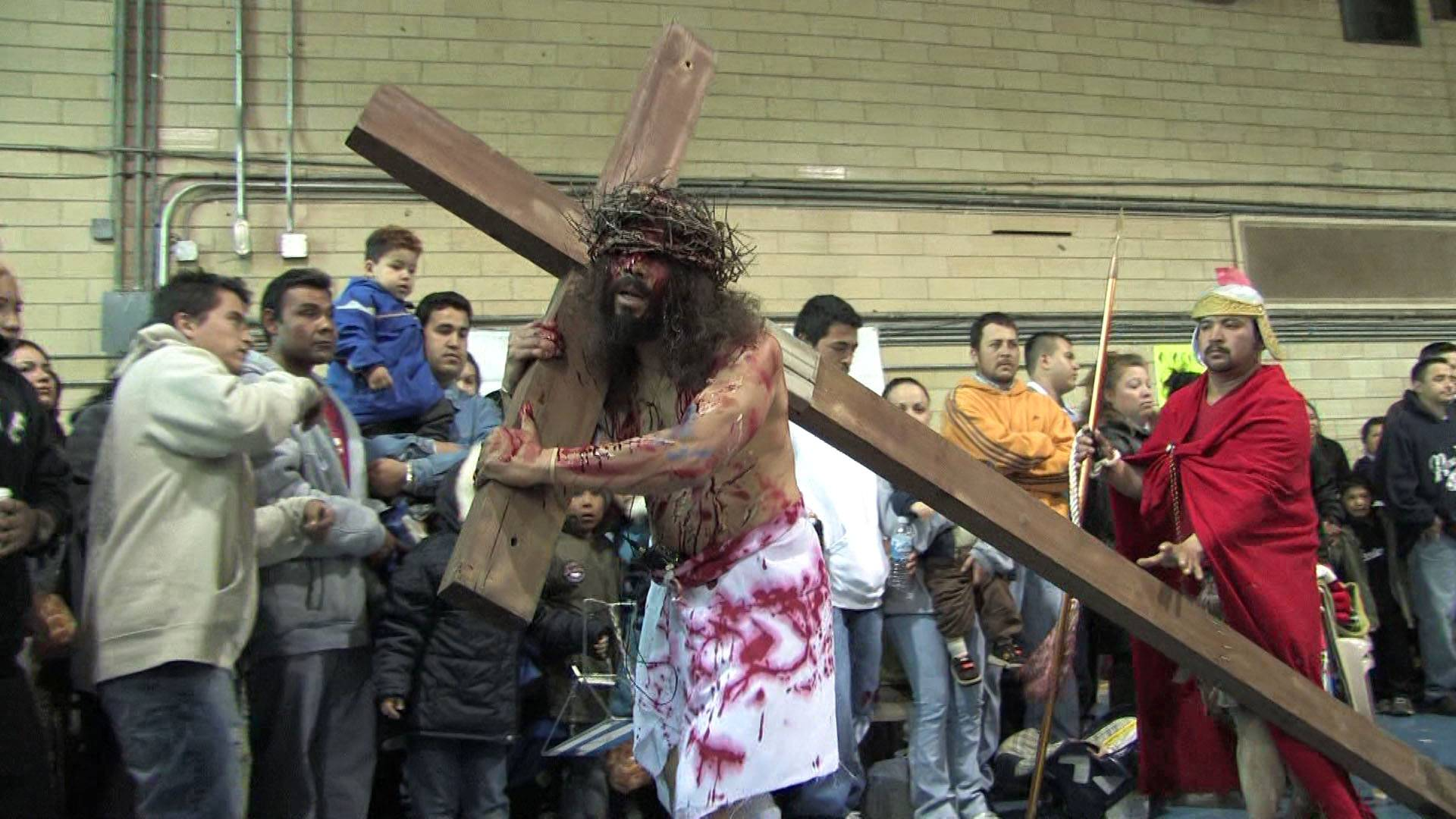 Romualdo Alvarado doesn't shrink from the burdens of accurately portraying Jesus as he carries the cross during a performance.
