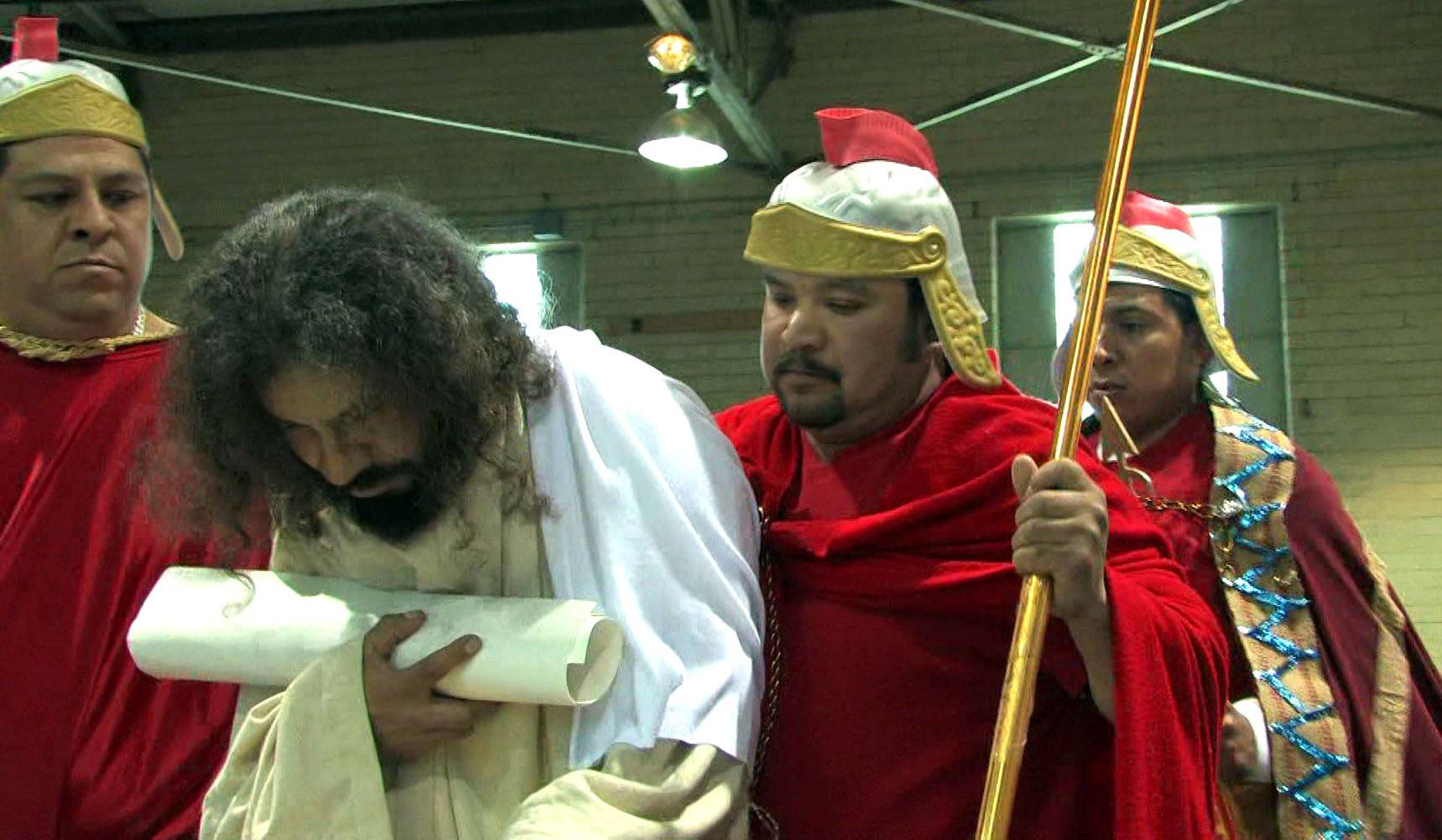 Alvarado portrays Jesus as Roman soldiers keep a close eye on him during Via Crucis, The Way of the Cross.