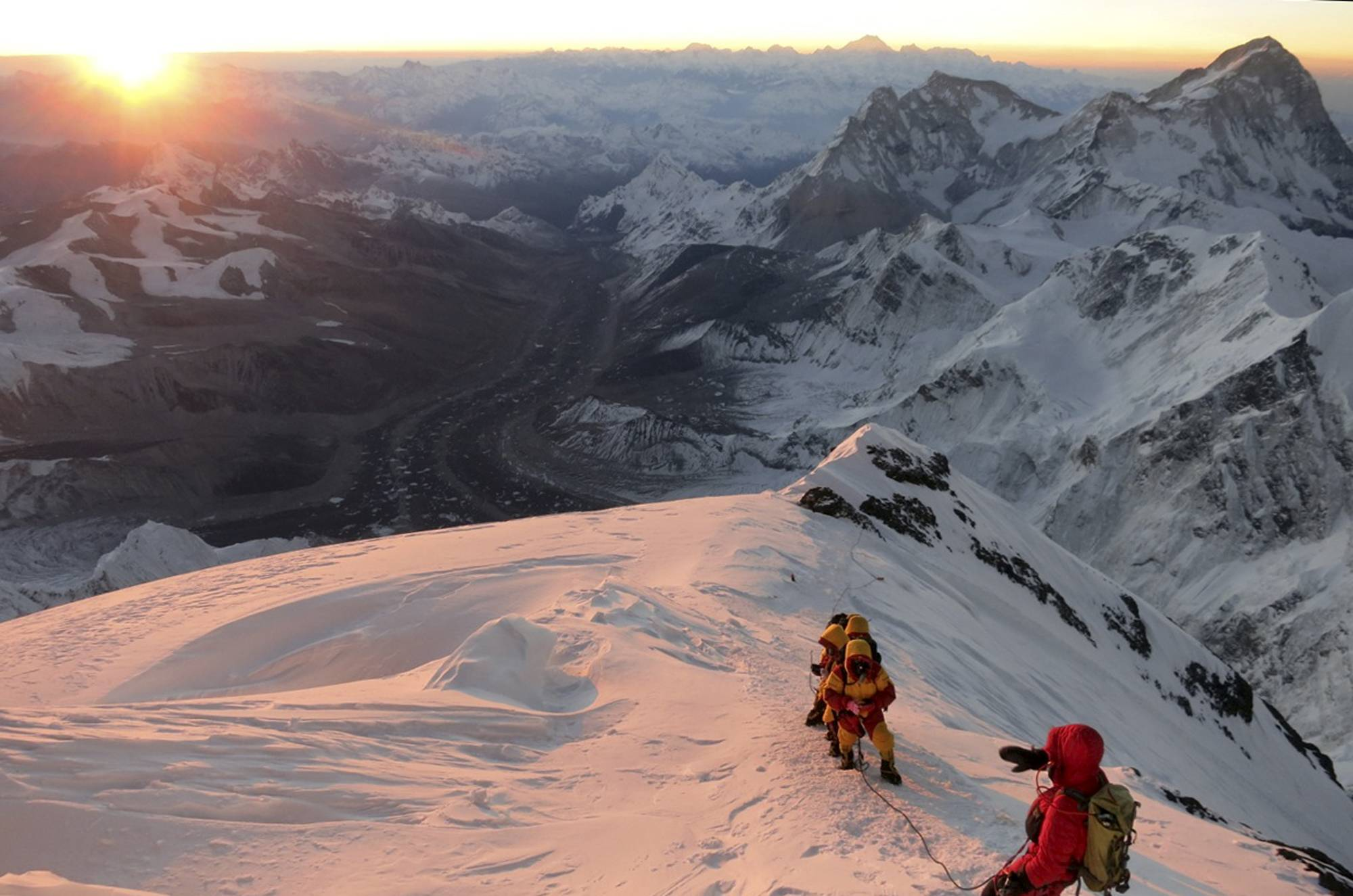 An avalanche swept down a climbing route on Mount Everest early Friday killing at least 12 Nepalese guides and leaving three missing in the deadliest disaster on the world's highest peak.
