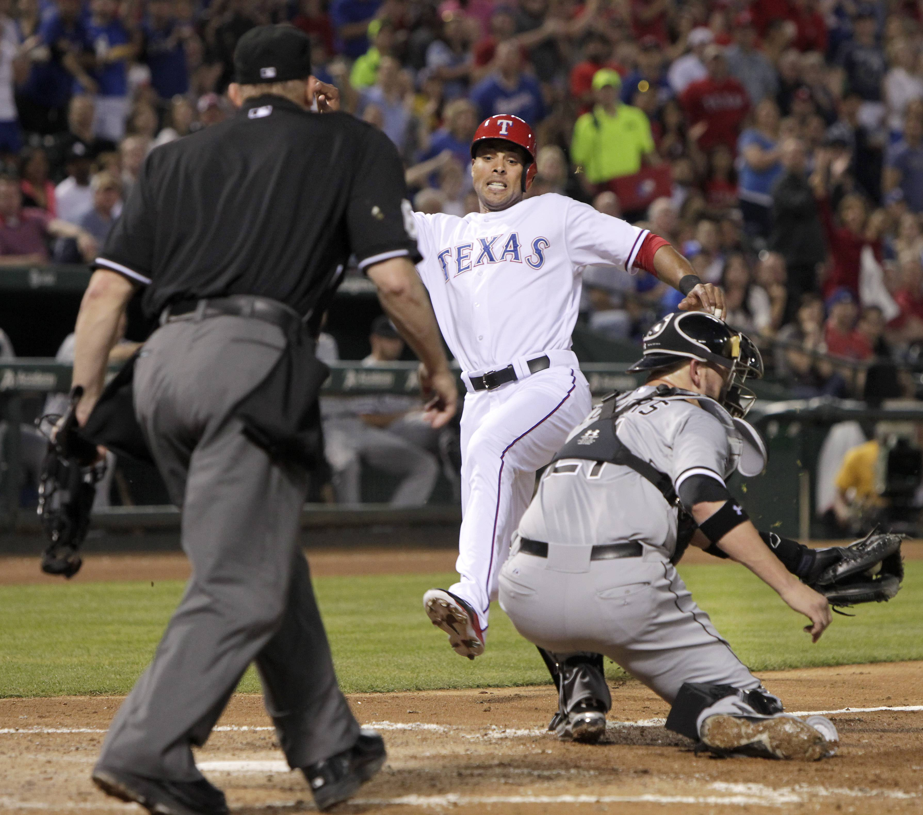Texas Rangers' Alex Rios (51) slides into home ahead of the tag from Chicago White Sox catcher Tyler Flowers (21) during the third inning of a baseball game Friday, April 18, 2014, in Arlington, Texas. The Rangers won 12-0. (AP Photo/The Dallas Morning News, Brad Loper) MANDATORY CREDIT, NO SALES, MAGS OUT, TV OUT, INTERNET USE BY AP MEMBERS ONLY