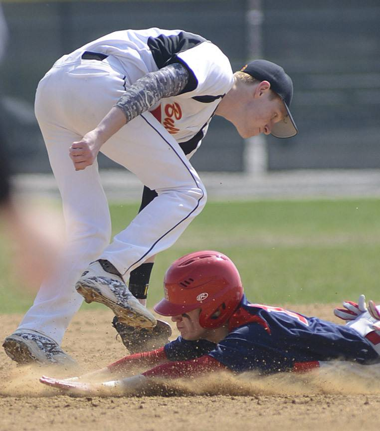 South Elgin's Nick Menken is safe at second base as Batavia's Andrew Siegler takes the throw in the first inning on Friday.