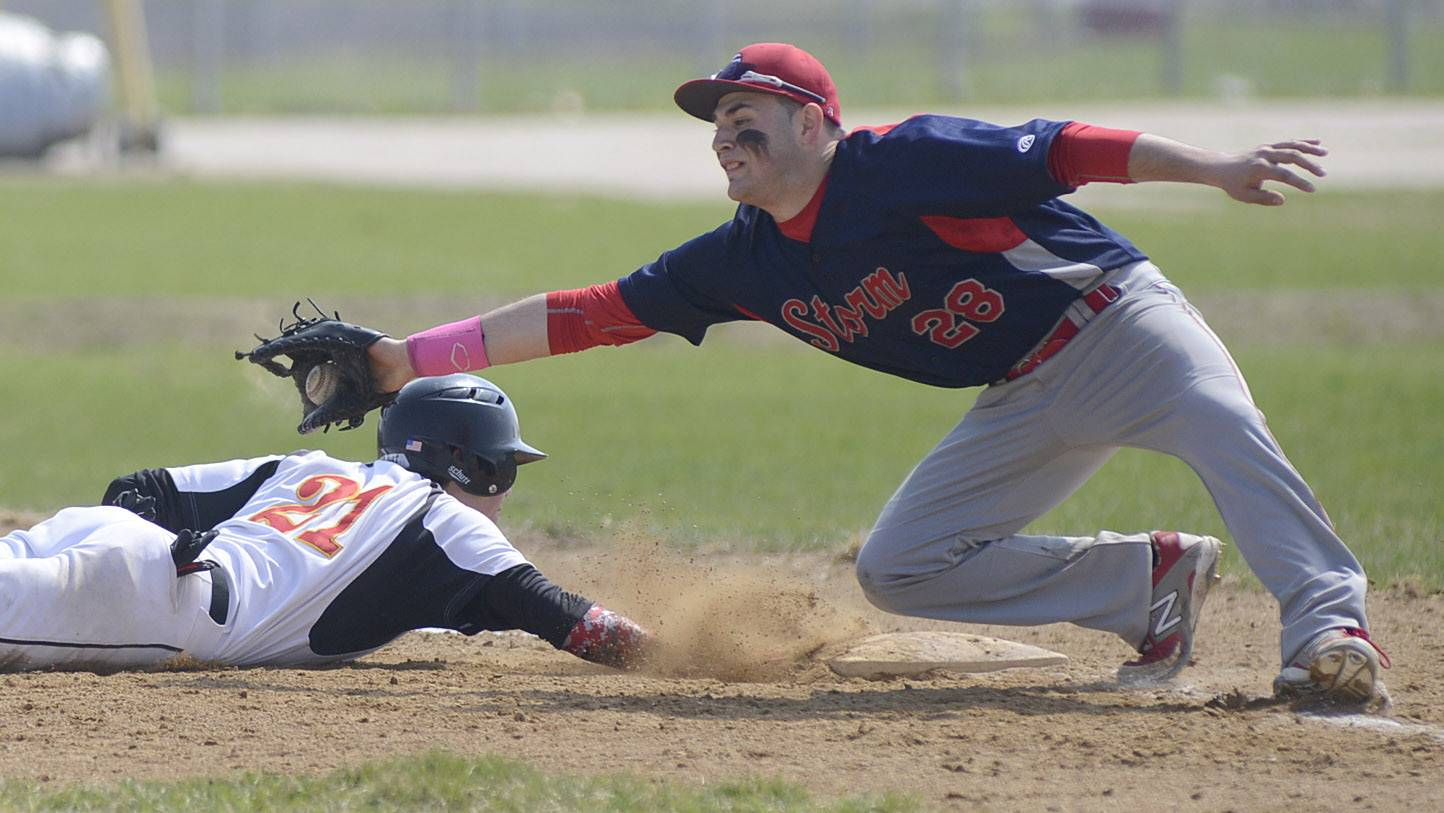Batavia's Jeremy Schoessling is safe at first base as South Elgin's Antonio Danesi takes the throw in the first inning on Friday.