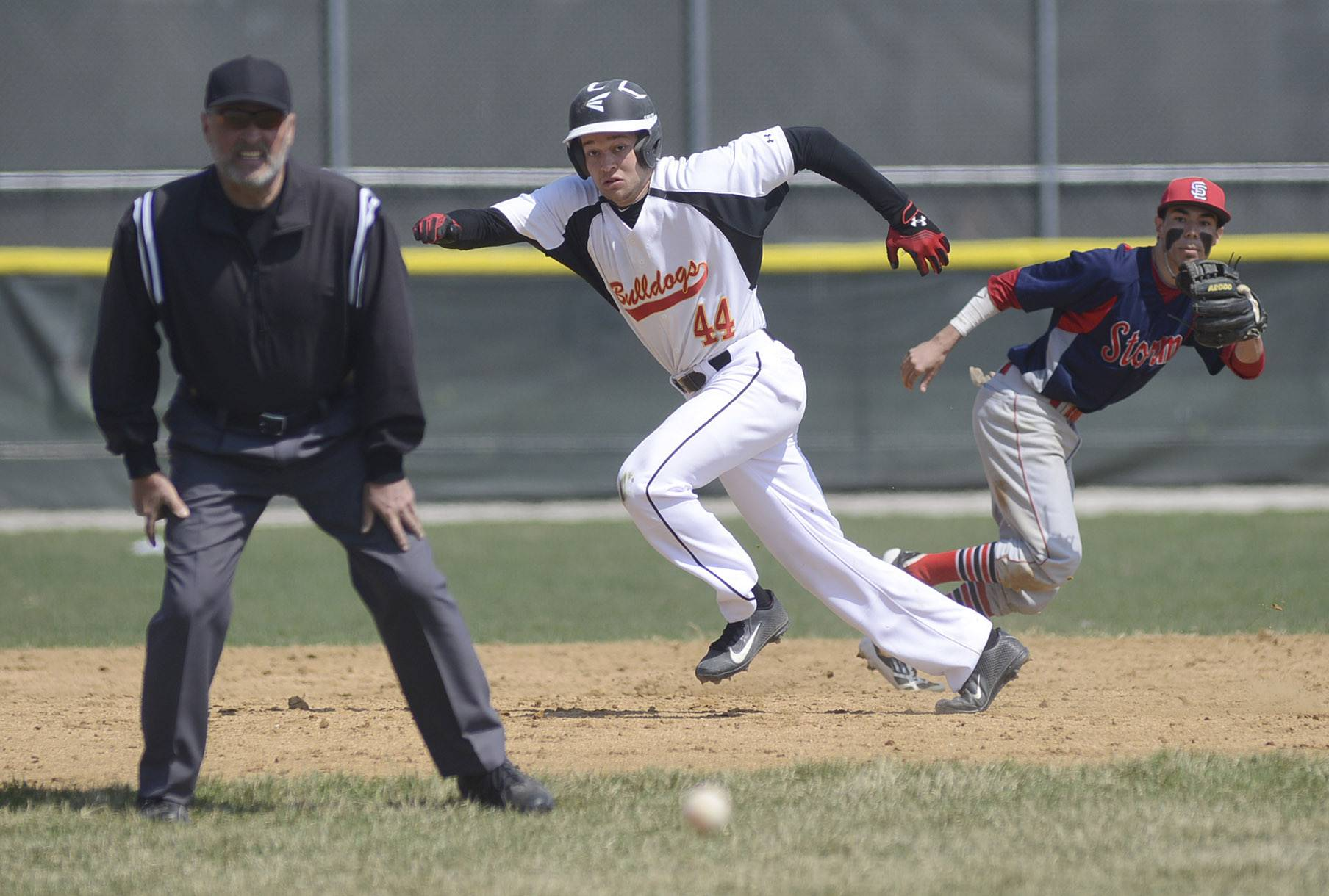 Batavia's Joe Gross takes off for third base as South Elgin's Dane Toppel runs in the opposite direction for the ball in the fourth inning on Friday.