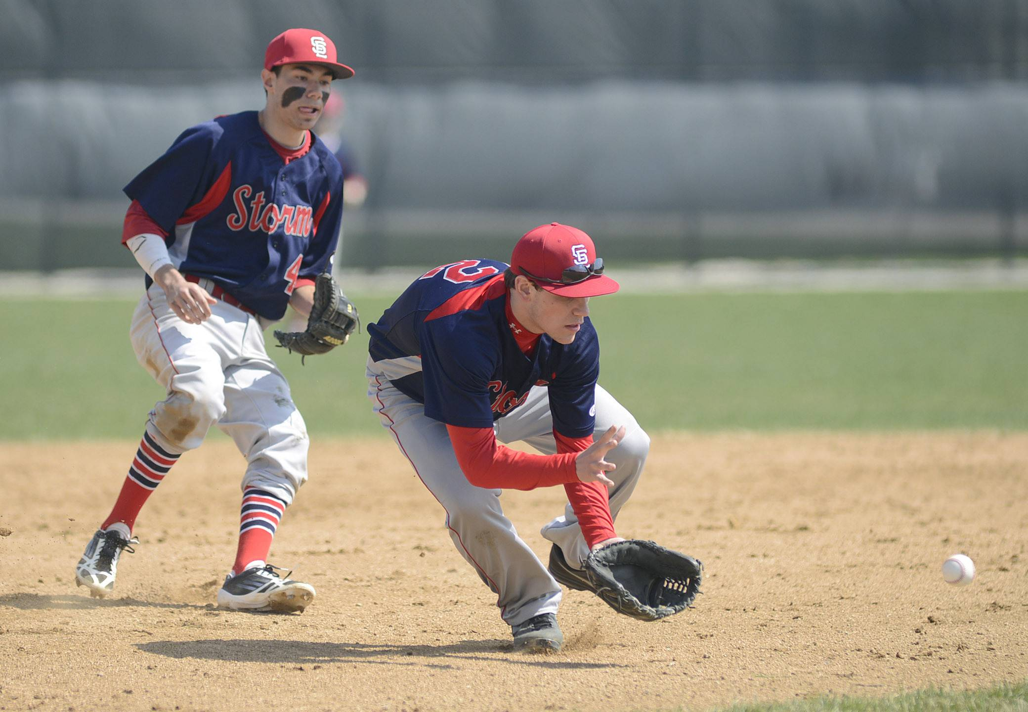 South Elgin's Kyle Hays scoops up a grounder Friday.