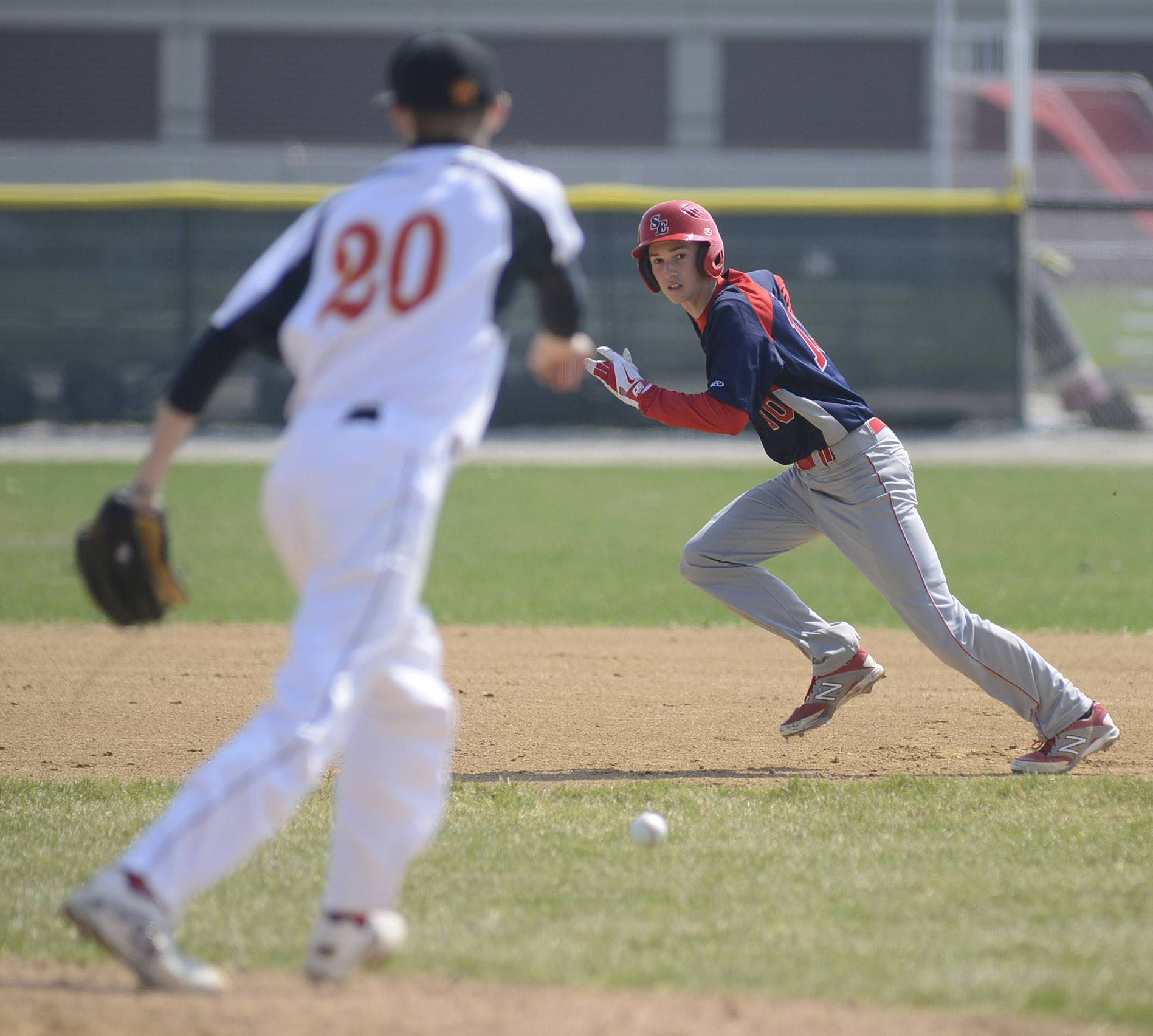 South Elgin's Danny Asa sprints for second base and past Batavia pitcher Colby Green after a ball is hit between the bases in the second inning on Friday.