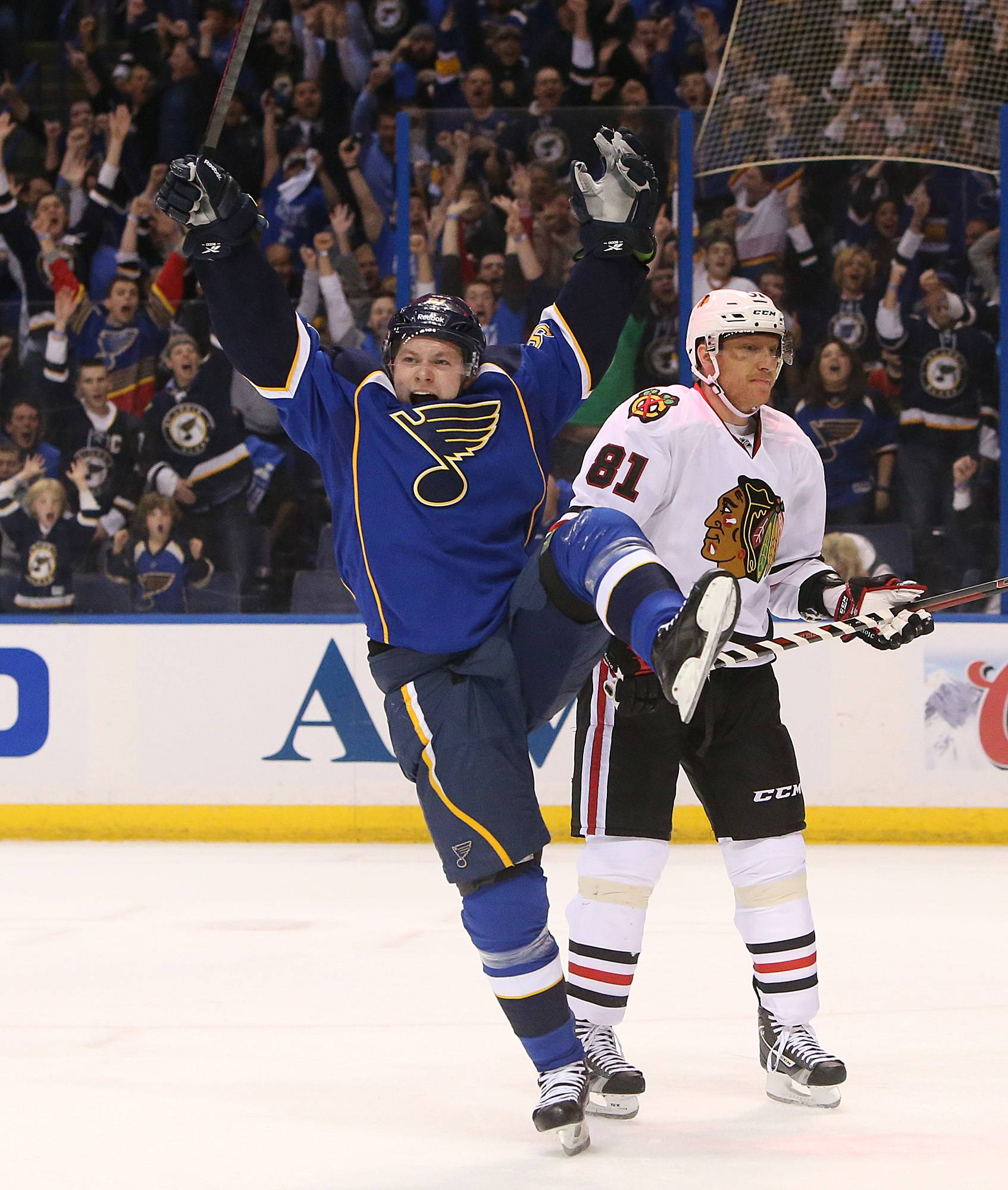 St. Louis Blues right wing Vladimir Tarasenko, left, reacts after scoring a goal against the Chicago Blackhawks during the first period of Game 1 of an NHL hockey opening-round playoff series, Thursday, April 17, 2014, in St. Louis. At right is Blackhawks' Marian Hossa. (AP Photo/St. Louis Post-Dispatch, Chris Lee) EDWARDSVILLE OUT  ALTON OUT