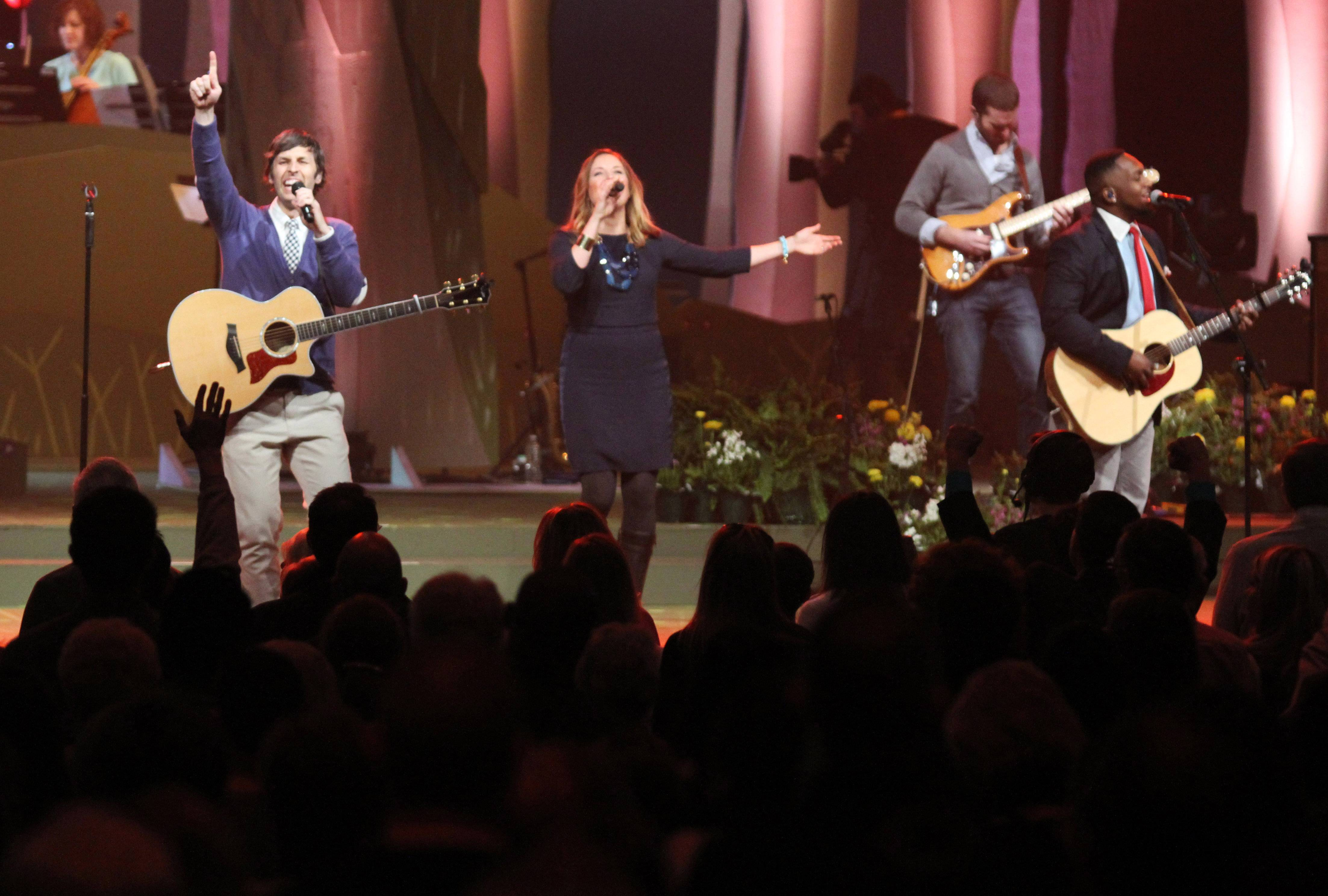 Worship leader Matt Lundgren, left, plays guitar as Becky Ykema sings with the church's musicians during the start of Easter services at Willow Creek Community Church on Saturday in South Barrington.