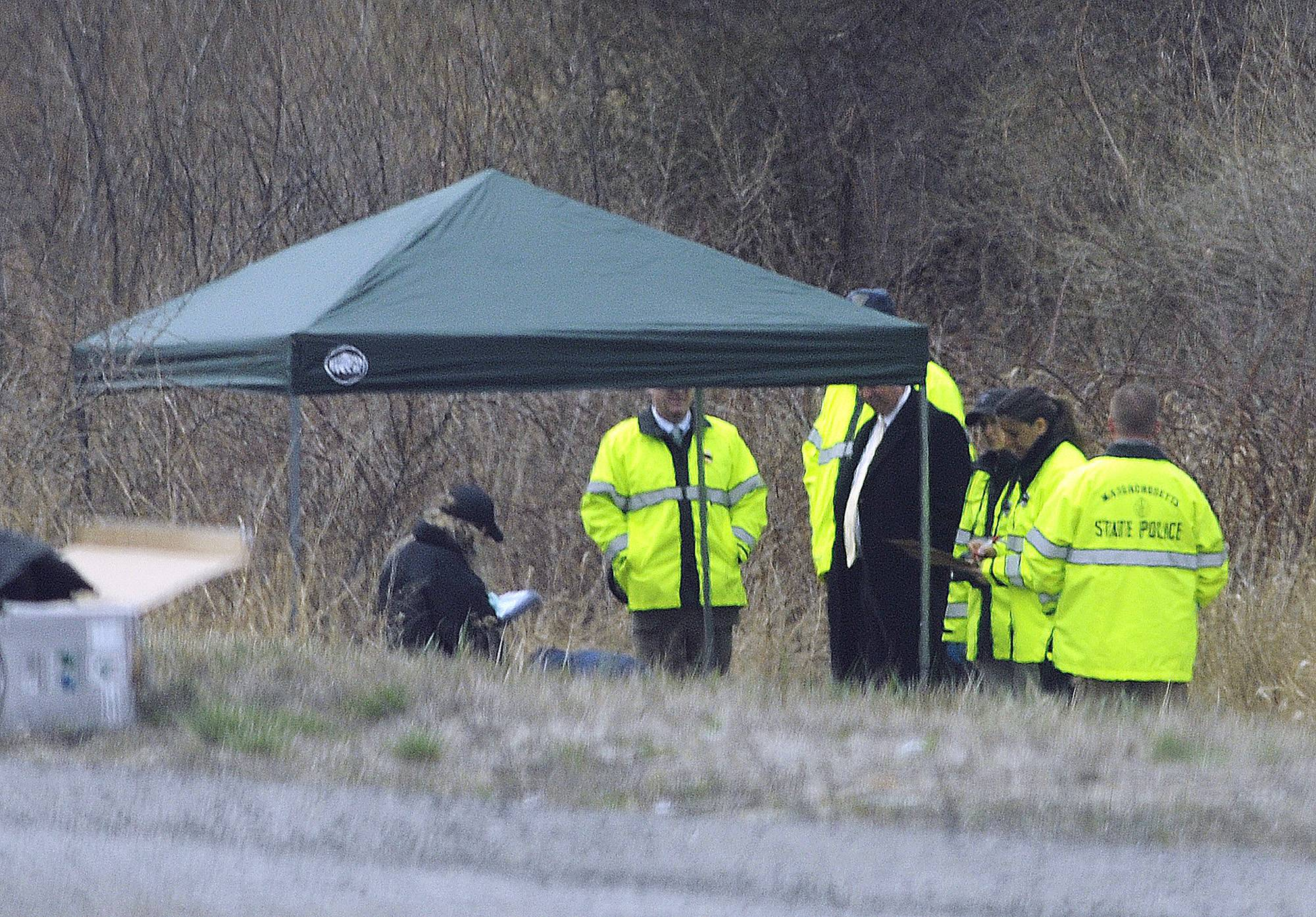 Massachusetts State Police stand along Interstate 190 Friday where police said a child's body was found.