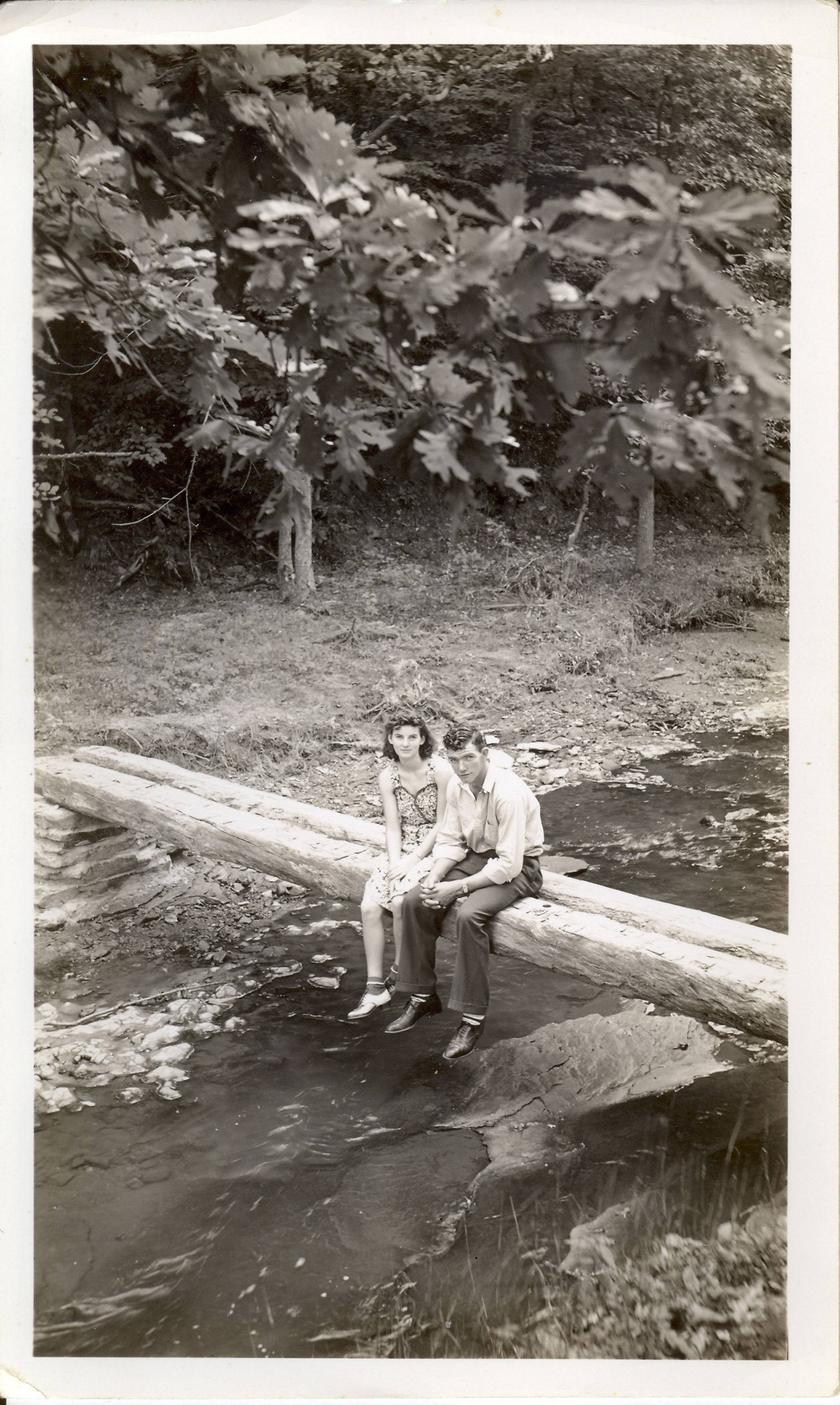 In this September 1940 photo provided by Dick Felumlee, Kenneth and Helen Felumlee of Nashport in central Ohio are shown sitting on a log north of Zanesville about four years before their marriage. T
