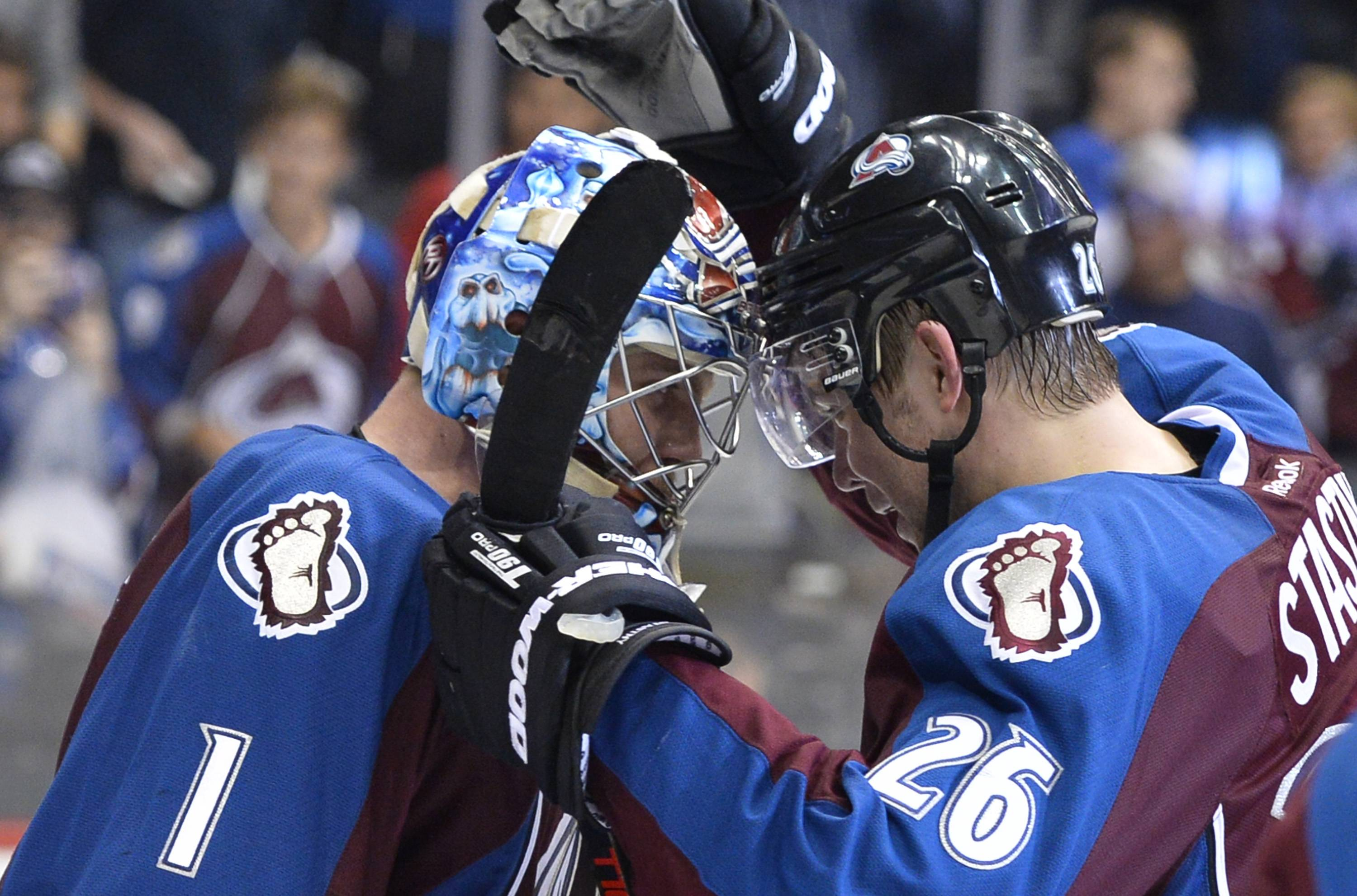 Colorado Avalanche goalie Semyon Varlamov (1) is congratulated by Paul Stastny (26) following the team's 4-2 win over the Minnesota Wild in Game 2 of an NHL hockey first-round playoff series Saturday in Denver. The Avalanche beat the Wild 4-2.