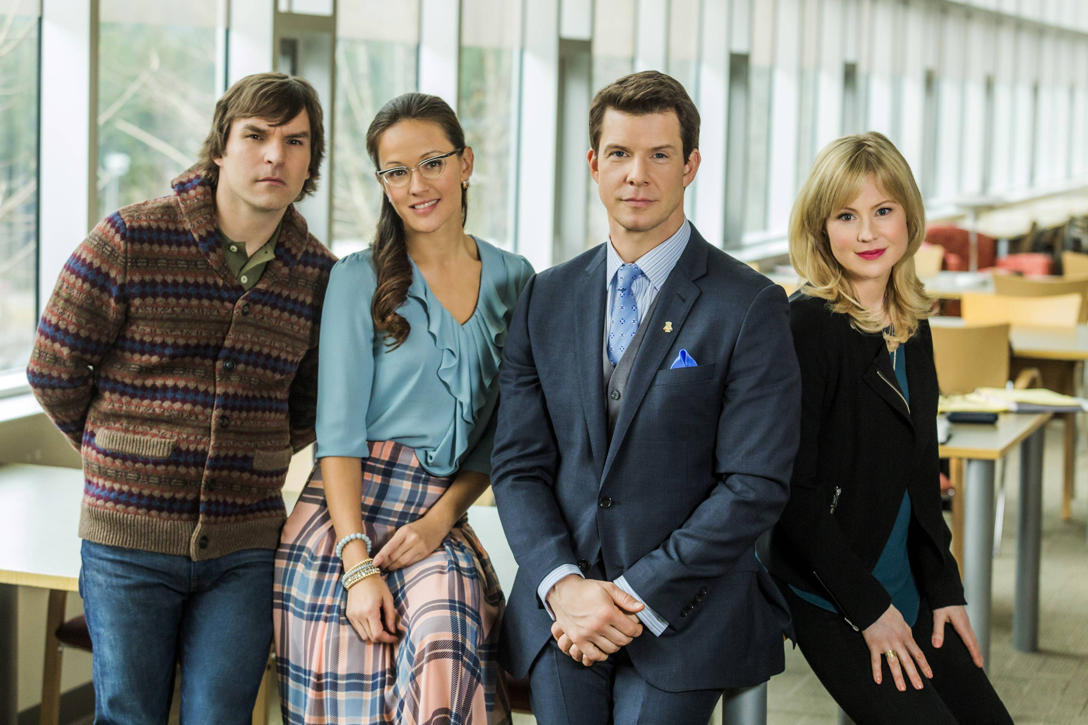 "This photo provided by Hallmark Channel shows, from left, Geoff Gustafson (""Norman Dorman""), Crystal Lowe (""Rita Haywith""), Eric Mabius (""Oliver O'Toole) and Kristin Booth (""Shane McInerny""), on the set of the TV series, ""Signed, Sealed, Delivered.""  The writer-producer Martha Williamson, who produced ""Touched by an Angel,"" returns to TV with the new Hallmark Channel show, debuting Sunday."