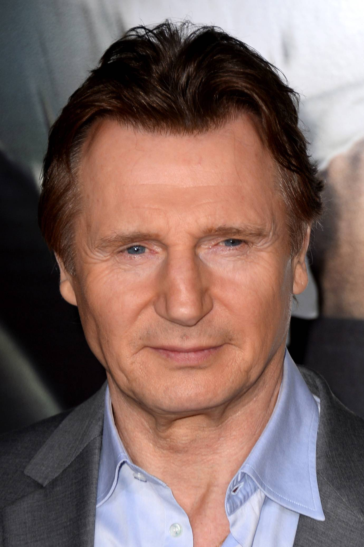 Animal-rights activists demonstrated outside Liam Neeson's New York home on Saturday to protest the actor's public stance that New York's carriage horses should keep working. Mayor Bill de Blasio has pledged to ban the horse-drawn carriages and replace them with electric vintage-style cars, commissioned by a group called NYCLASS.