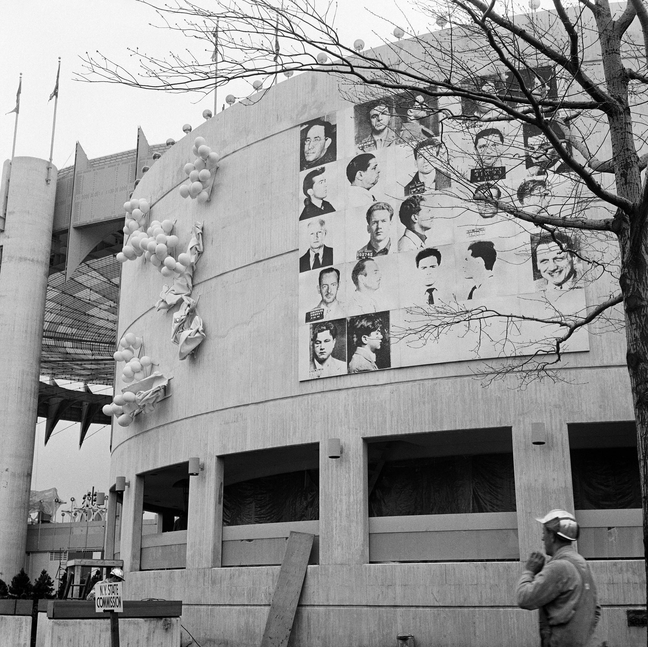 A 20x20 foot mural depicting mug shots of the NYPD's 13 most-wanted criminals by Andy Warhol is mounted on the curved facade of the New York State Pavilion at the 1964 New York World's Fair in the Queens borough of New York. T