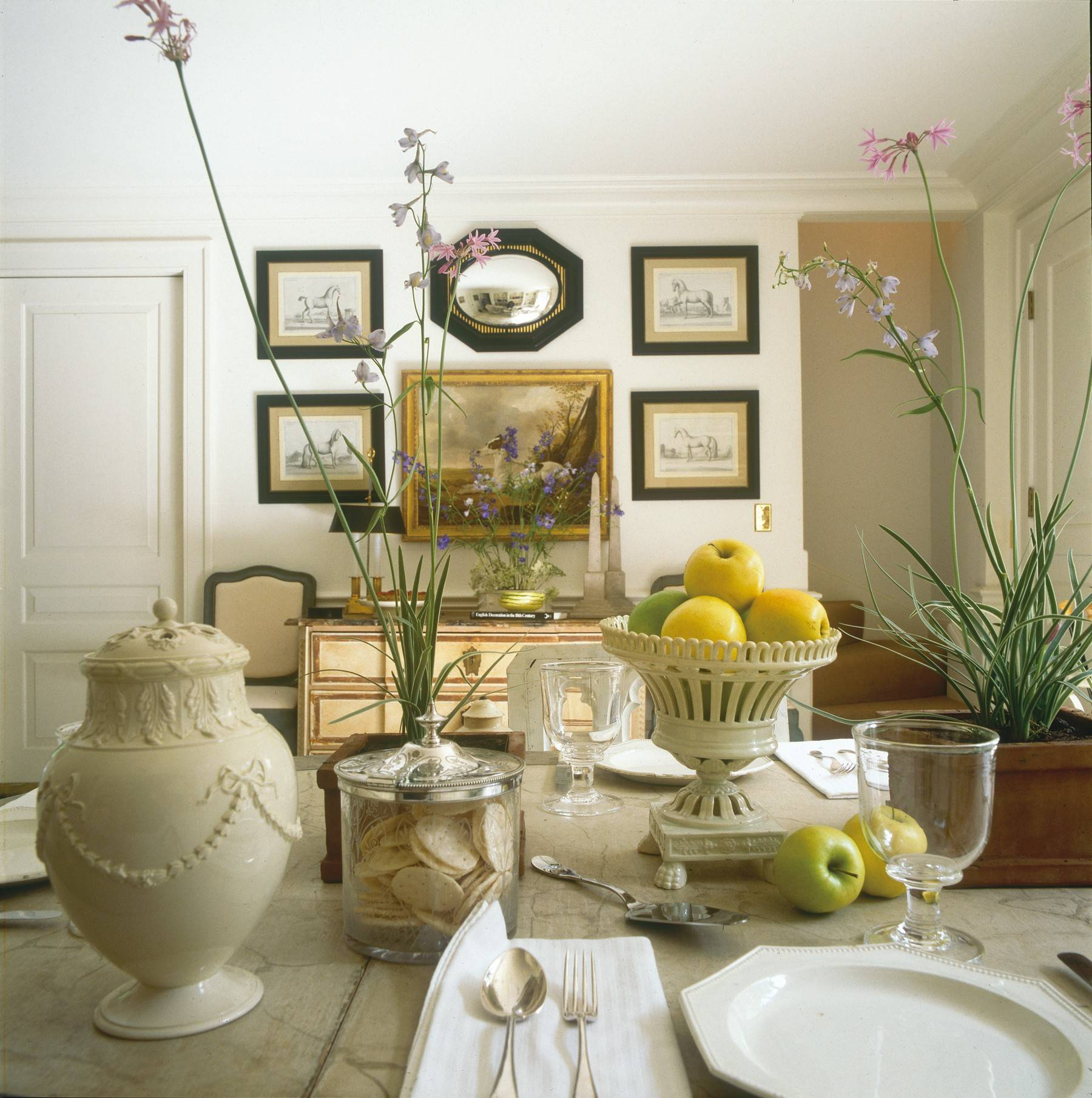 A carefully composed wall arrangement is a key decorative element in a relaxed, inviting dining room.
