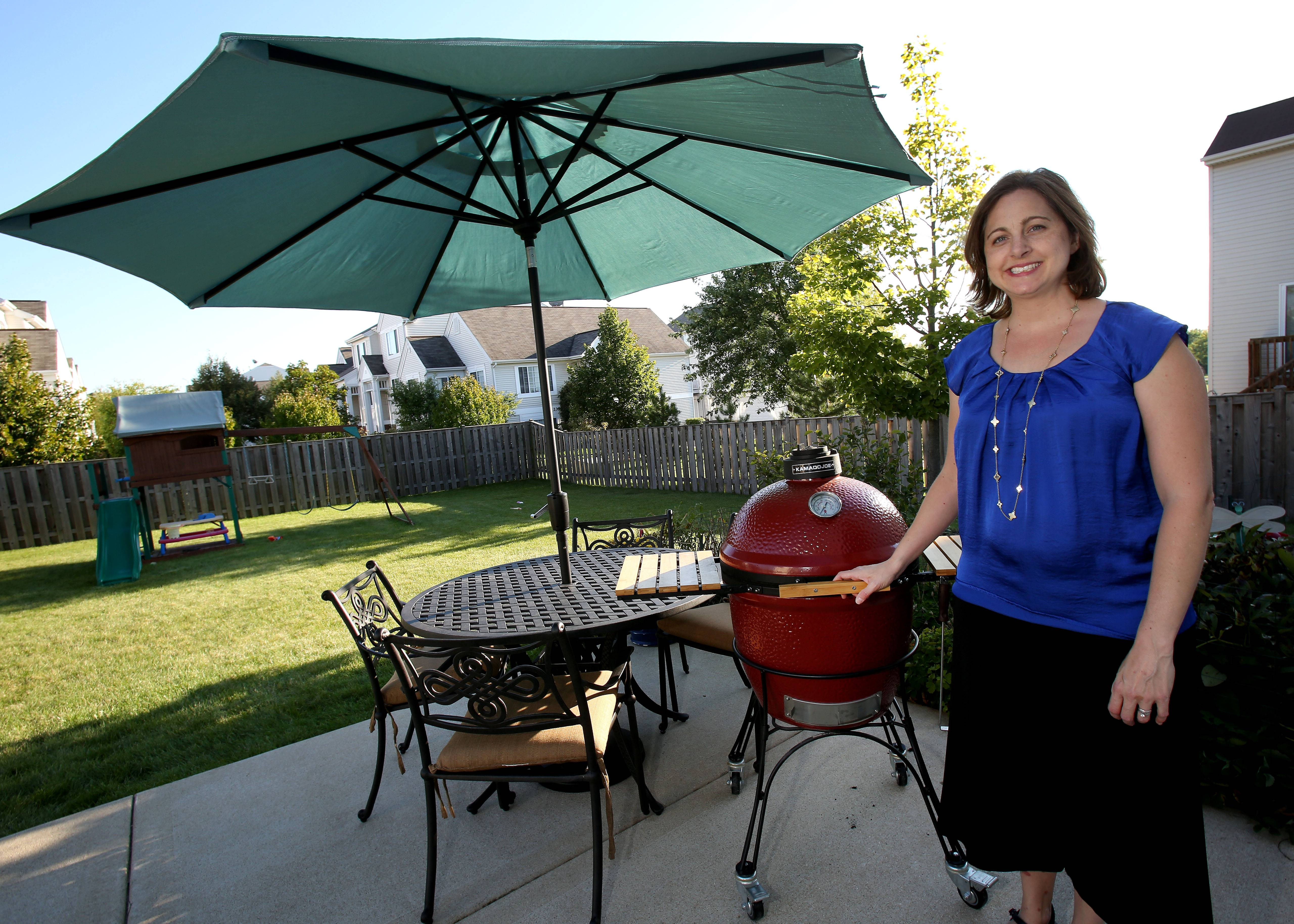 Amy Dawes of Aurora enjoys entertaining with her new patio furniture from Viking Patio and Ski in Barrington and Kamado Joe slow cooker courtesy of Northwest Metalcraft in Arlington Heights.