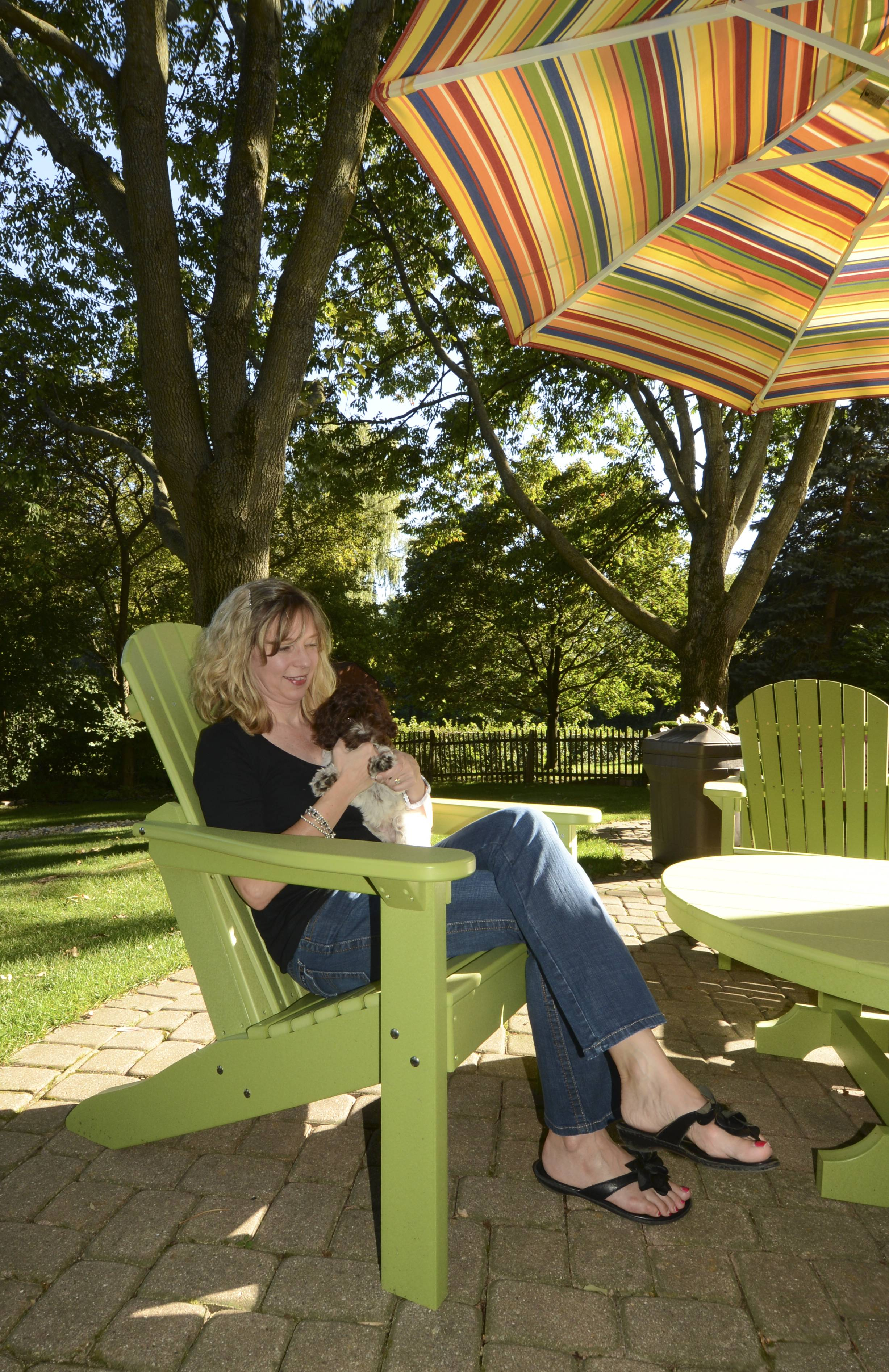 Rose Waber of Wheaton and her puppy, Sadie, enjoy a new Adirondack chair patio set from Hearth and Home in Mount Prospect.