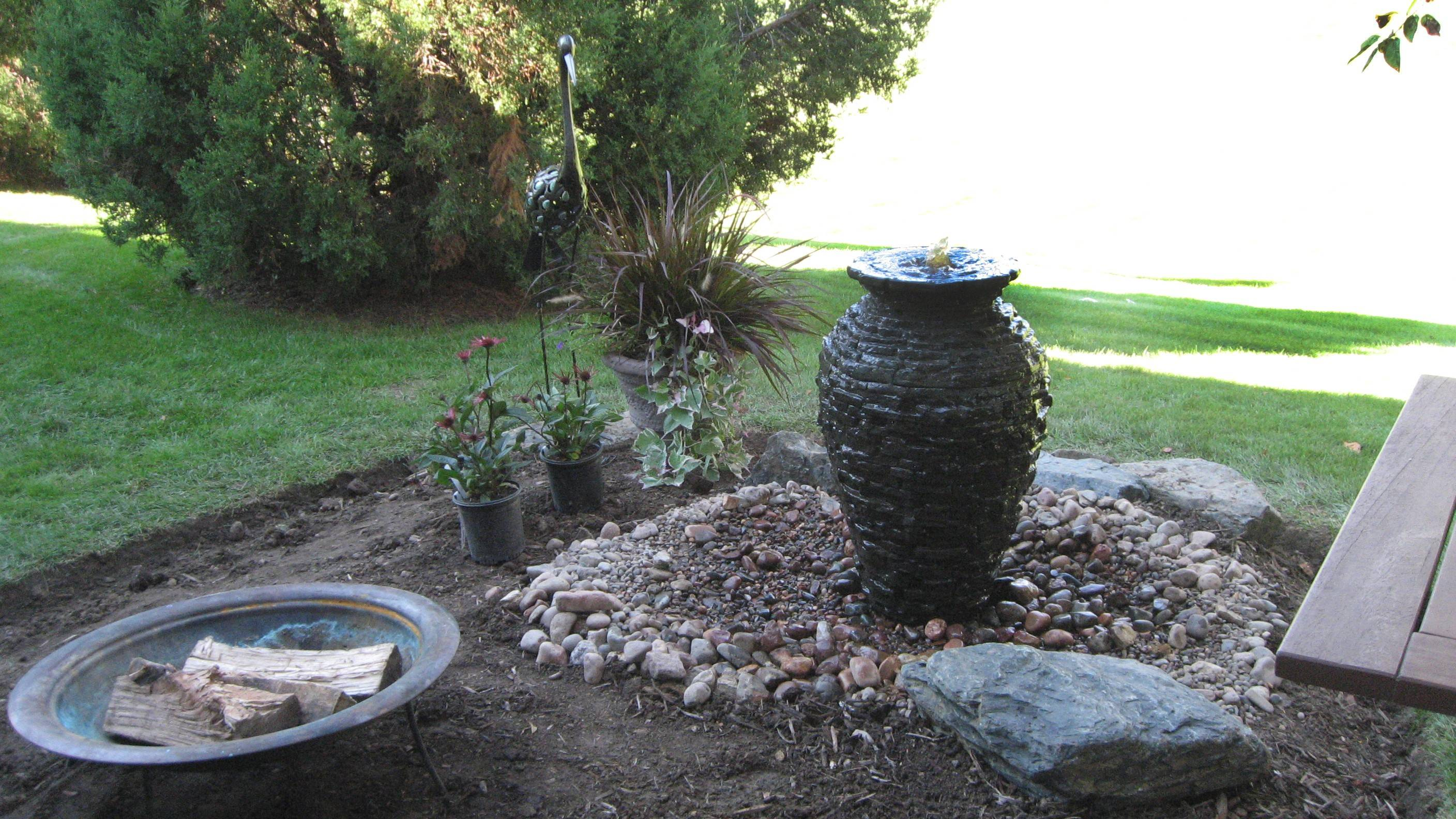 Cindy Parcher of East Dundee can relax on her patio with a bubbling urn water feature from Aquascape Designs, lighting package from Northwest Lighting and Accents, a Solaire infrared grill, and goodies from GFS and Binny's.