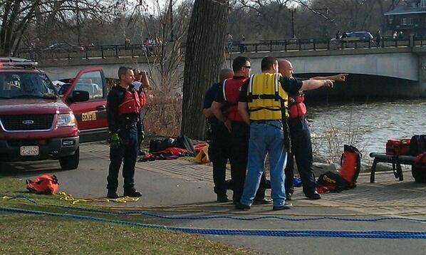 Fire officials and emergency responders gather Saturday afternoon where two men lost control of their kayak near an area on the Fox River in Geneva. A 26-year-old man died after he got stuck in the kayak.