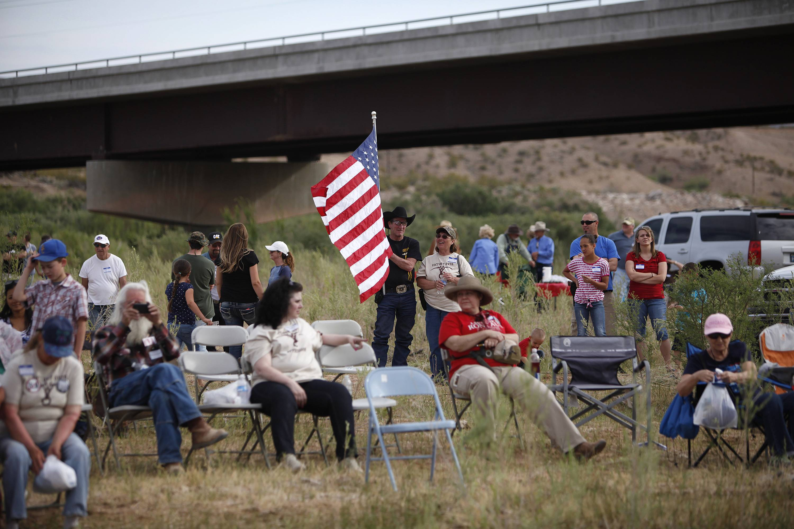 People gather Friday along the Virgin River during a rally in support of Cliven Bundy near Bunkerville, Nev.