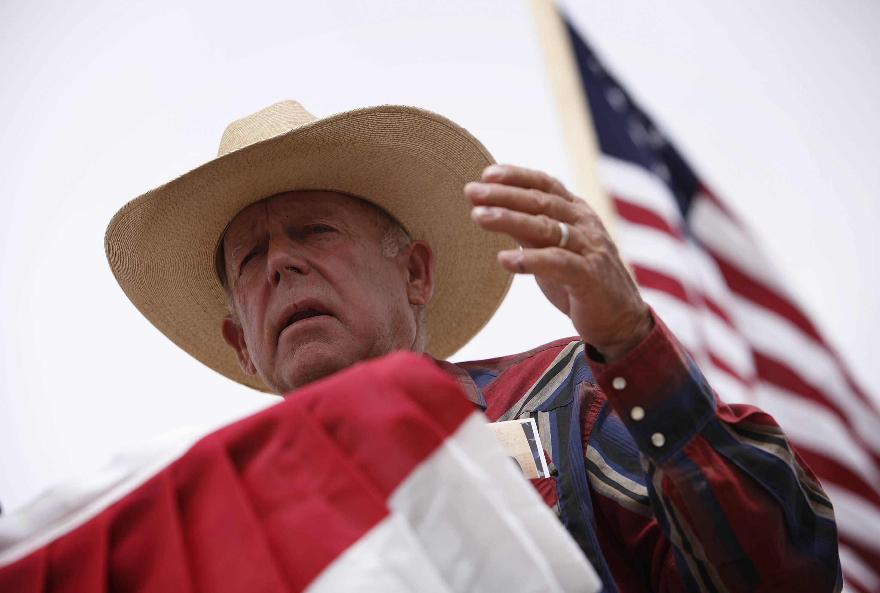 Rancher Cliven Bundy speaks Friday at a protest camp near Bunkerville, Nev.