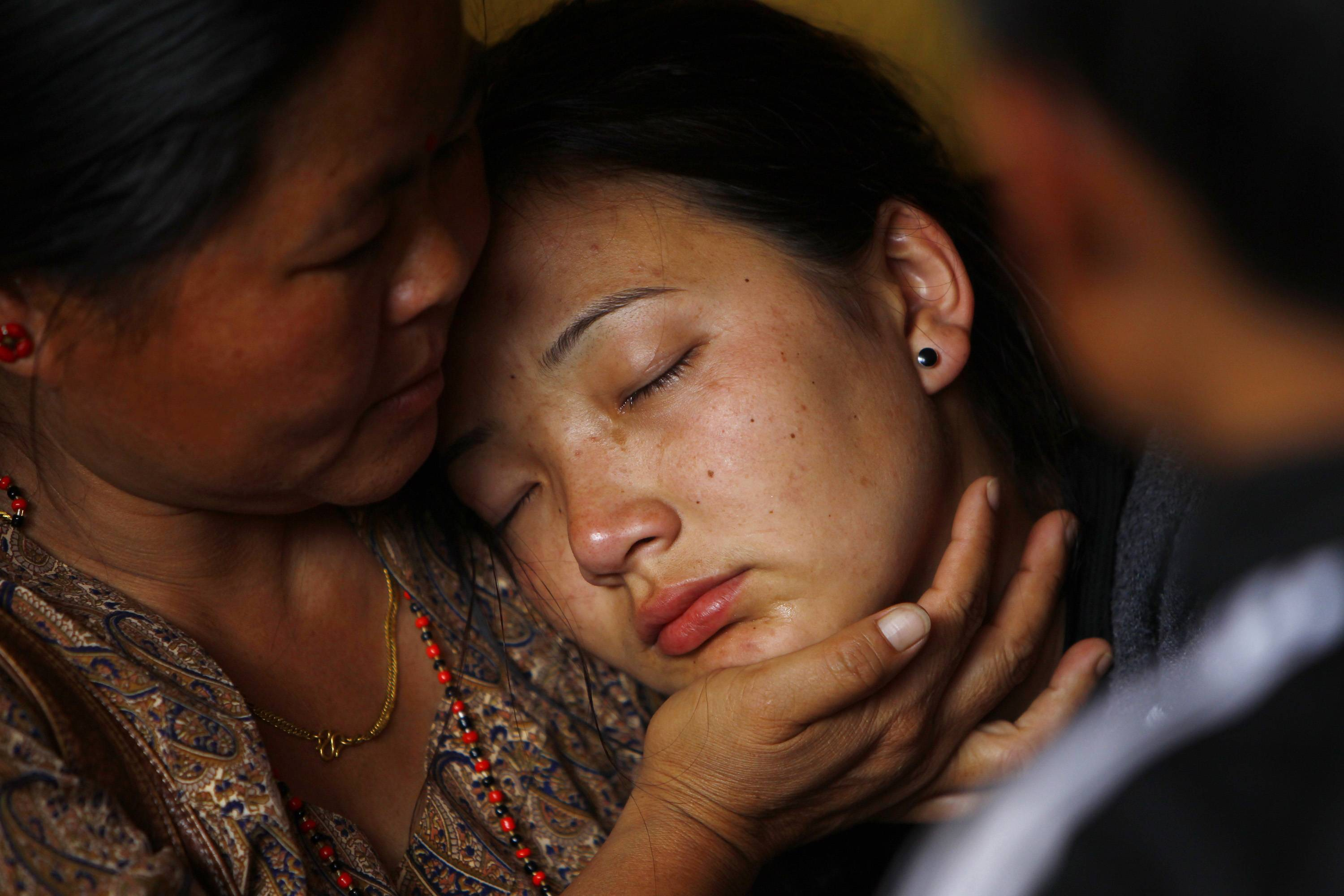 Daughter of Nepalese mountaineer Ang Kaji Sherpa, killed in an avalanche on Mount Everest, cries Saturday as her father's body is brought to the Sherpa Monastery in Katmandu, Nepal.