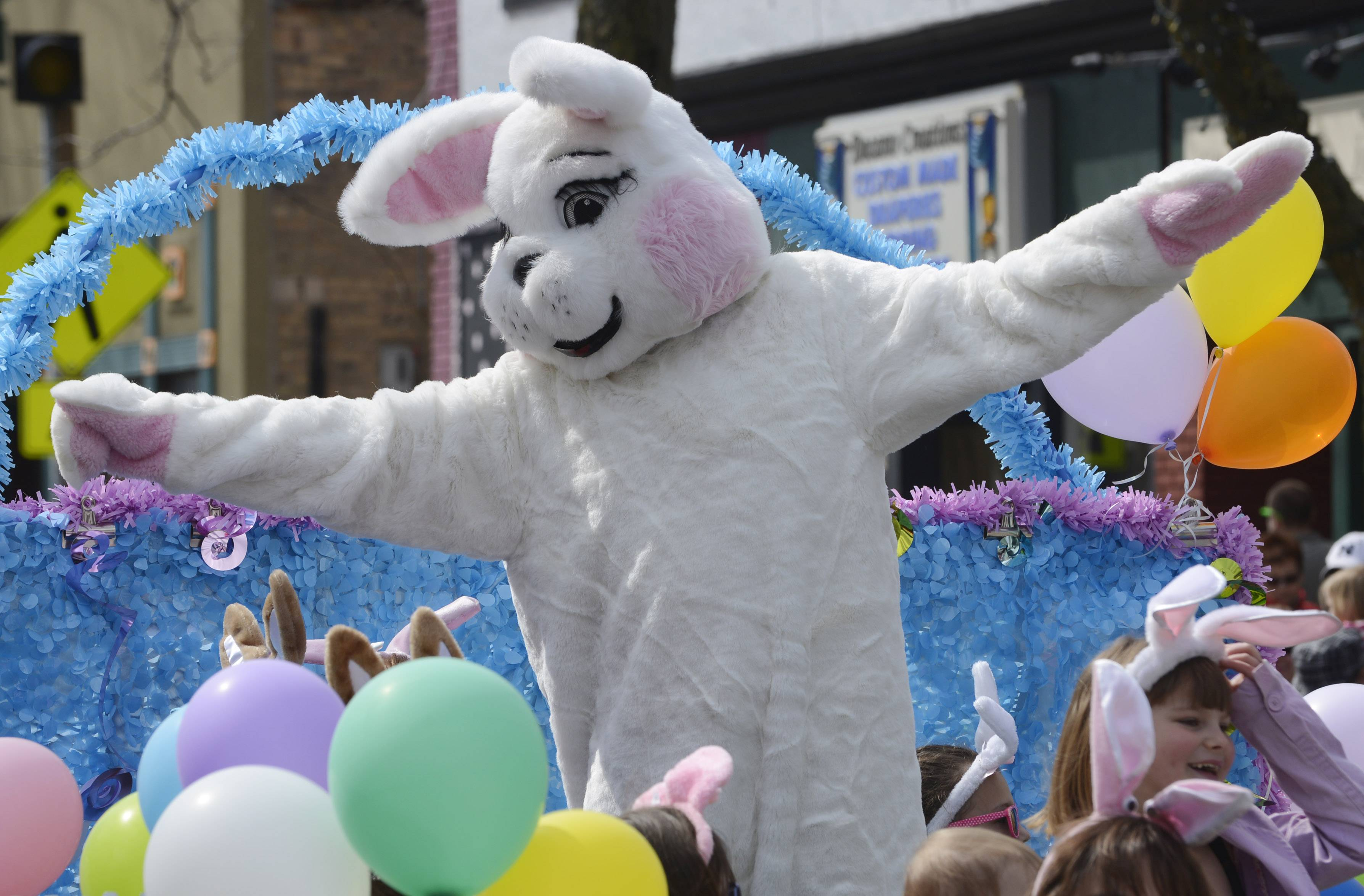The Easter Bunny rides his float at the conclusion of Saturday's Easter parade on Main Street in Antioch.