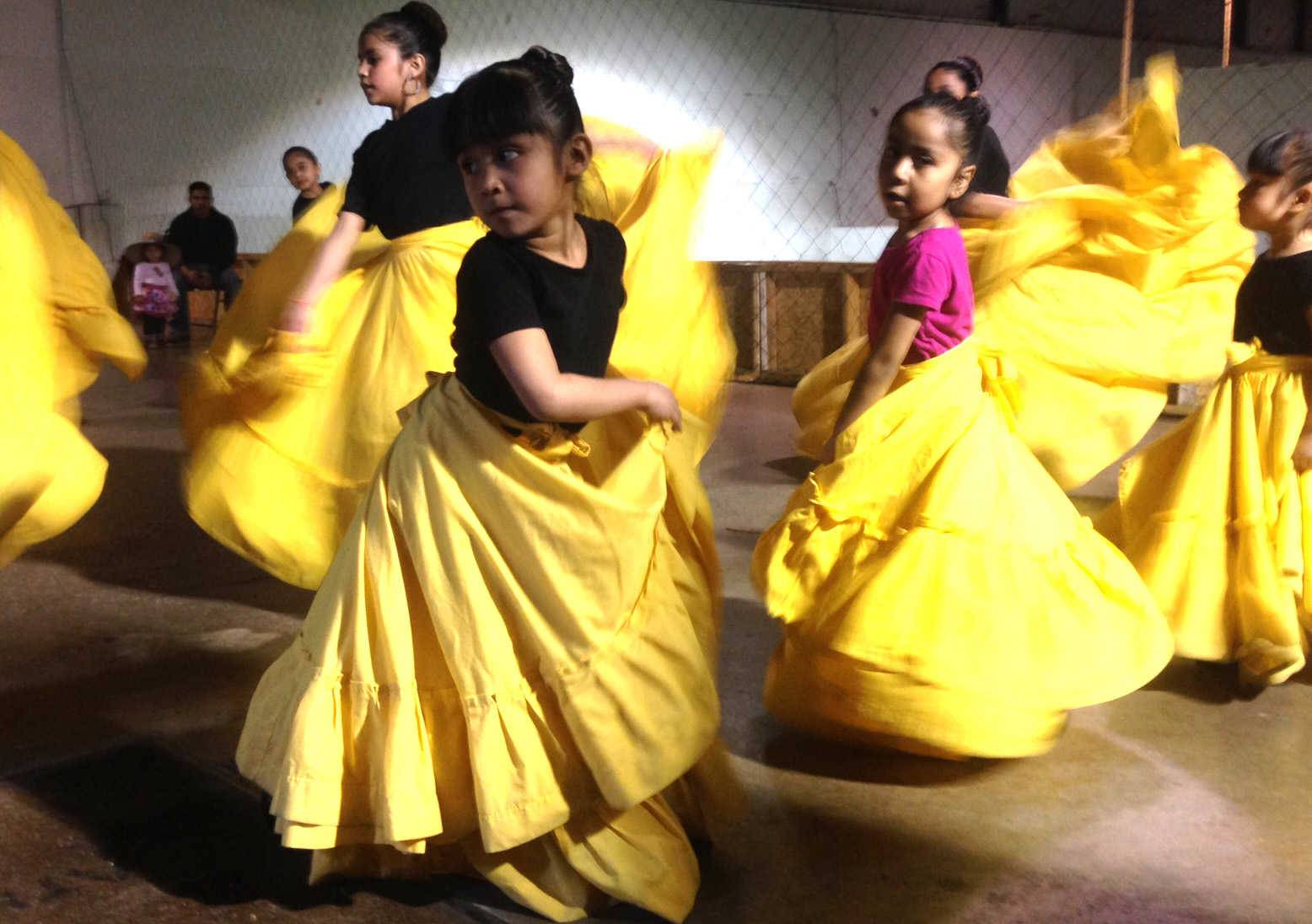 Estrellita Salas, front left, and Luz Maria Zambrano, with the pink shirt, both 5 years old and from Elgin, practice with Ballet Folklorico Girasol Thursday at Grand Plaza El Mesias mall in Elgin.