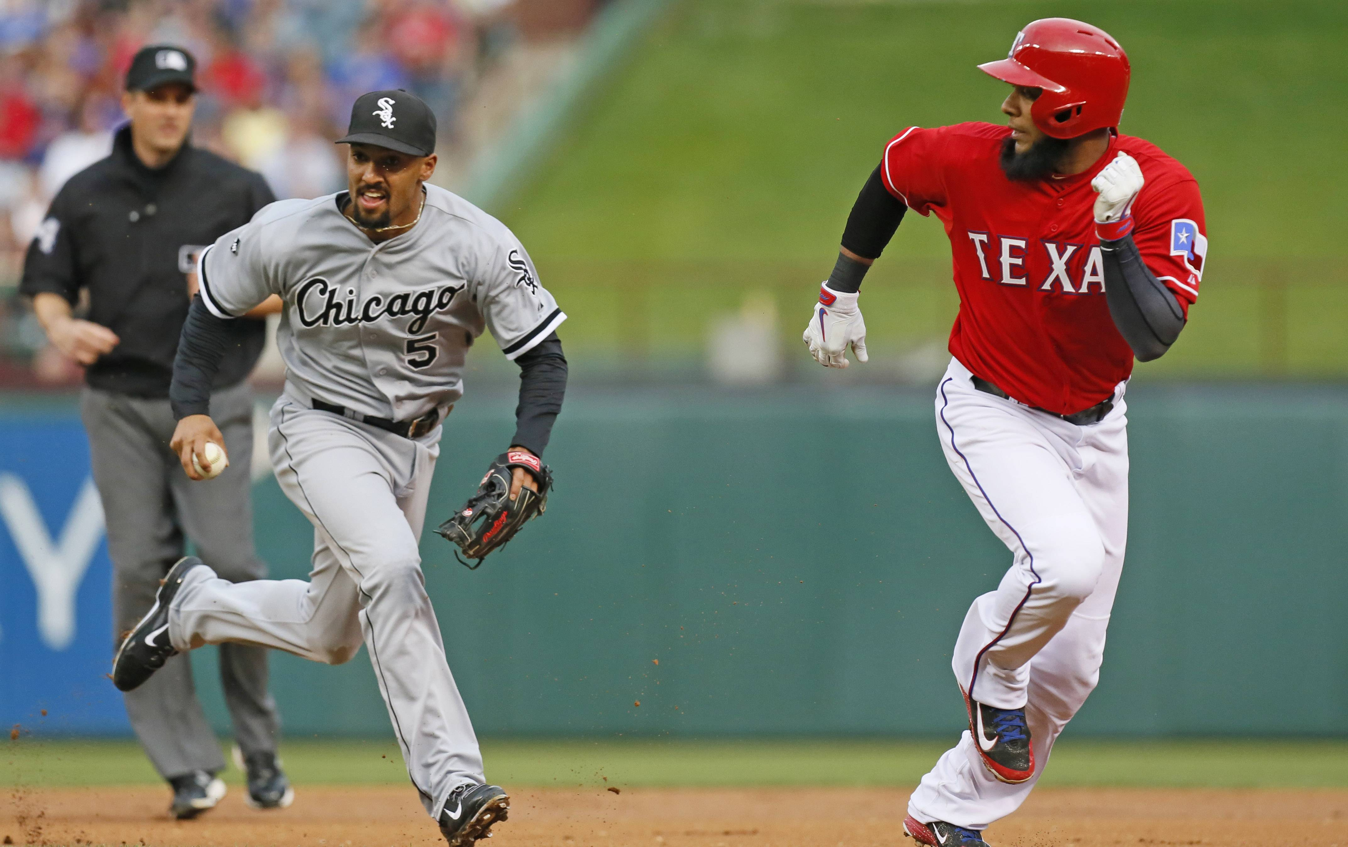 Texas Rangers' Elvis Andrus, right, gets caught in a rundown between first and second base as White Sox second baseman Marcus Semien (5) closes in during Saturday's game in Texas. The Sox lost 6-3.