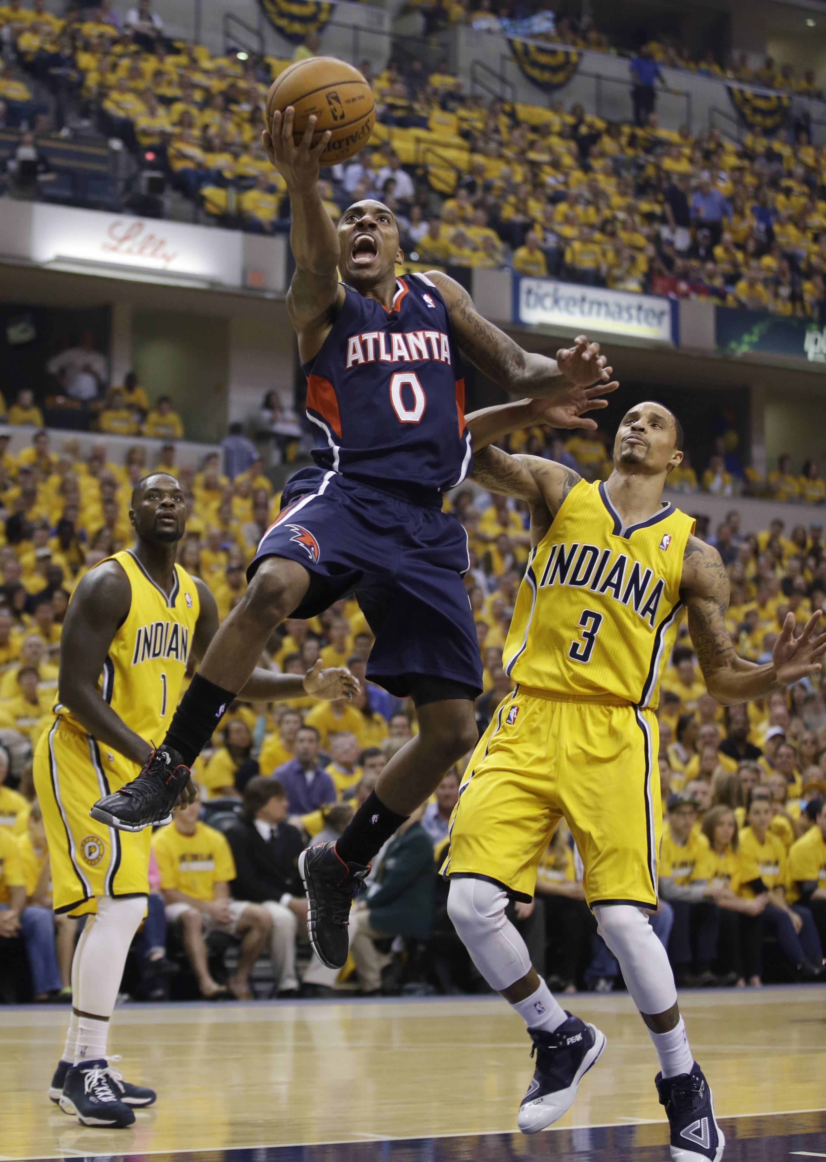 The Atlanta Hawks' Jeff Teague shoots against Indiana Pacers' George Hill during Game 1 of an opening-round NBA basketball playoff series Saturday in Indianapolis.