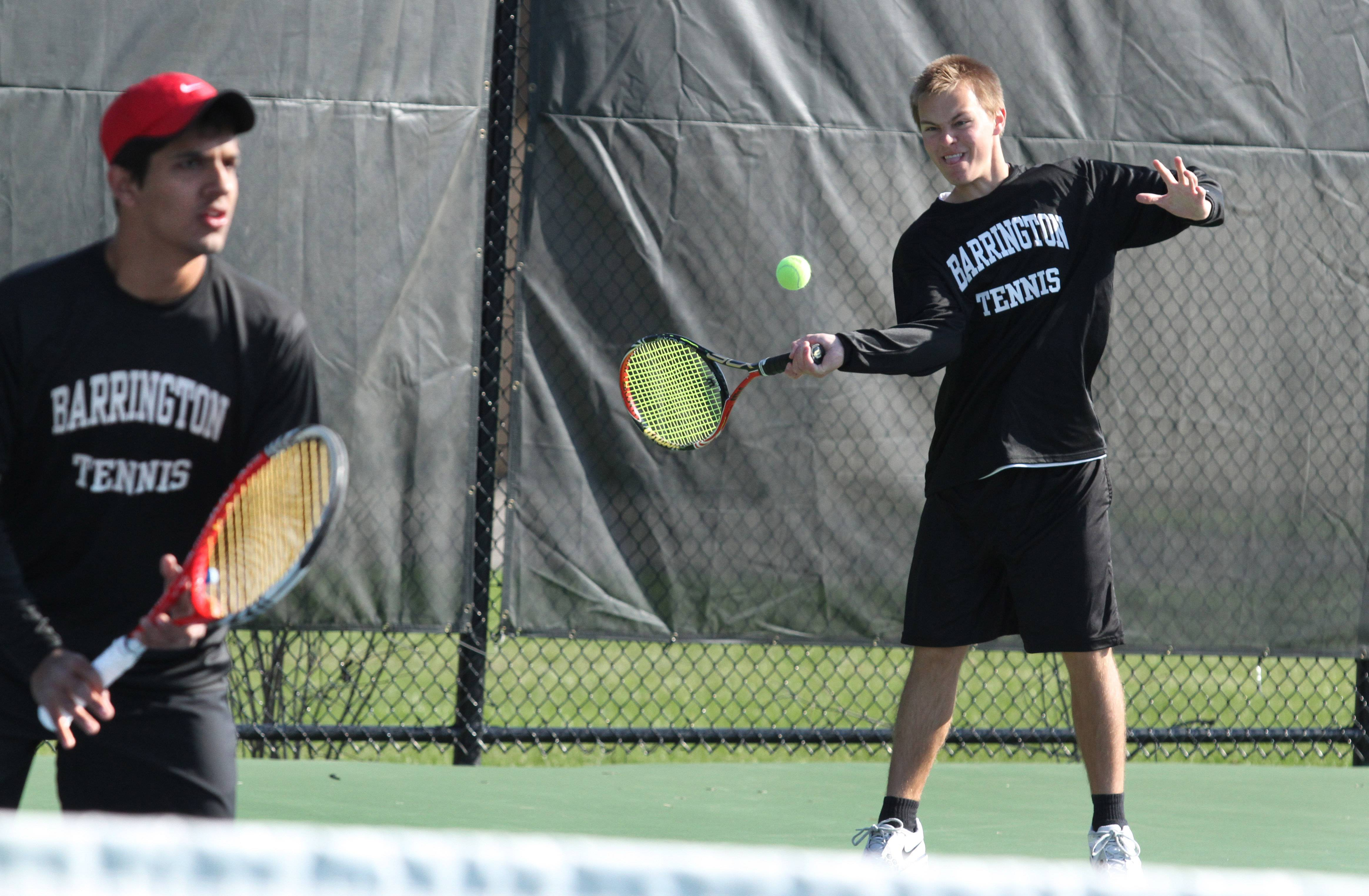 Barrington's doubles team of Scott Apmann, right, and Ishaan Jaglan compete against Warren's Sam Gudeman and John Westerberg at Forest View Racquet Club on Saturday in Arlington Heights.