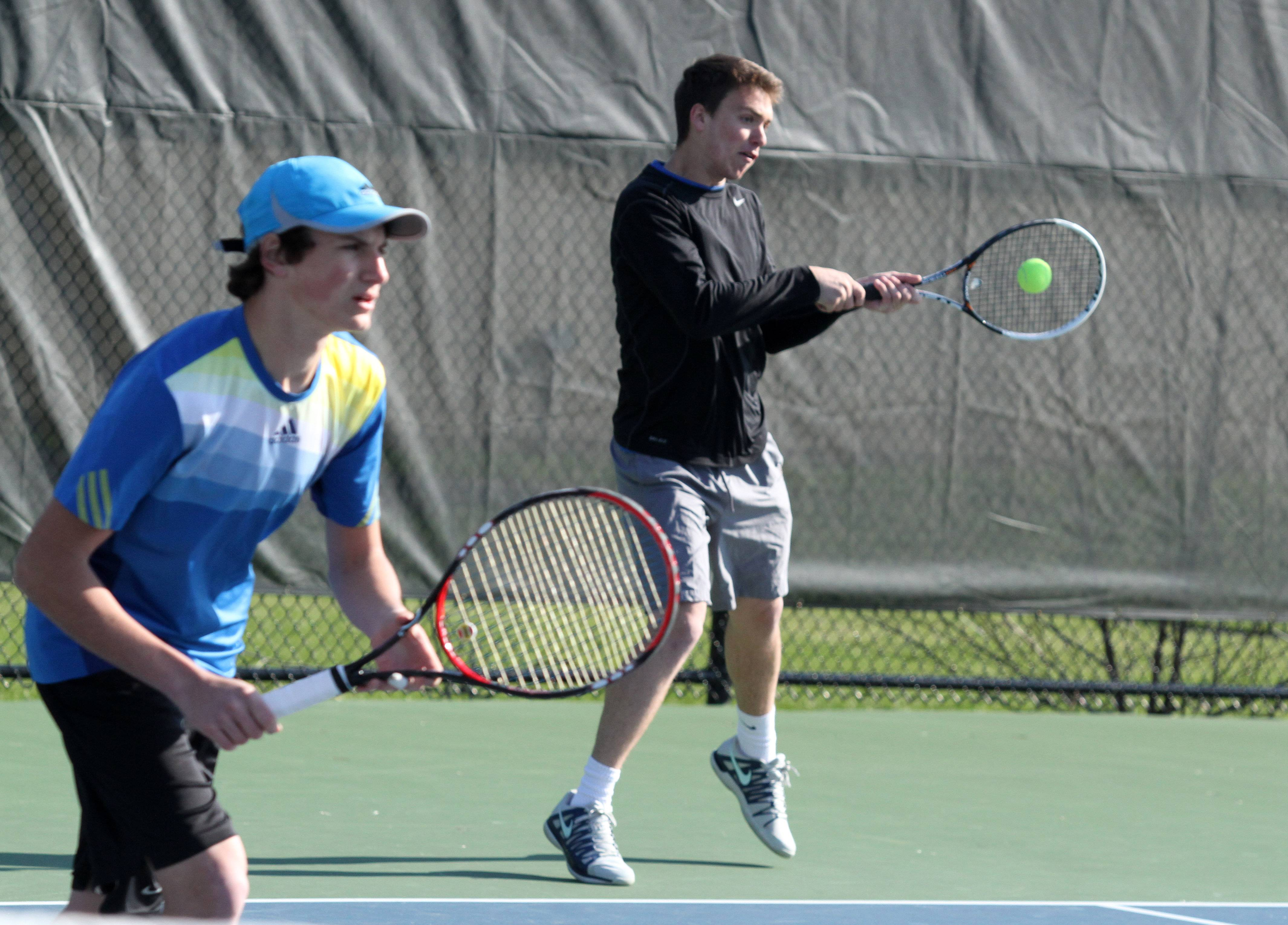 Warren's John Westerberg, serving, and doubles teammate Sam Gudeman compete against Barrington during Saturday's action at Forest View Racquet Club.