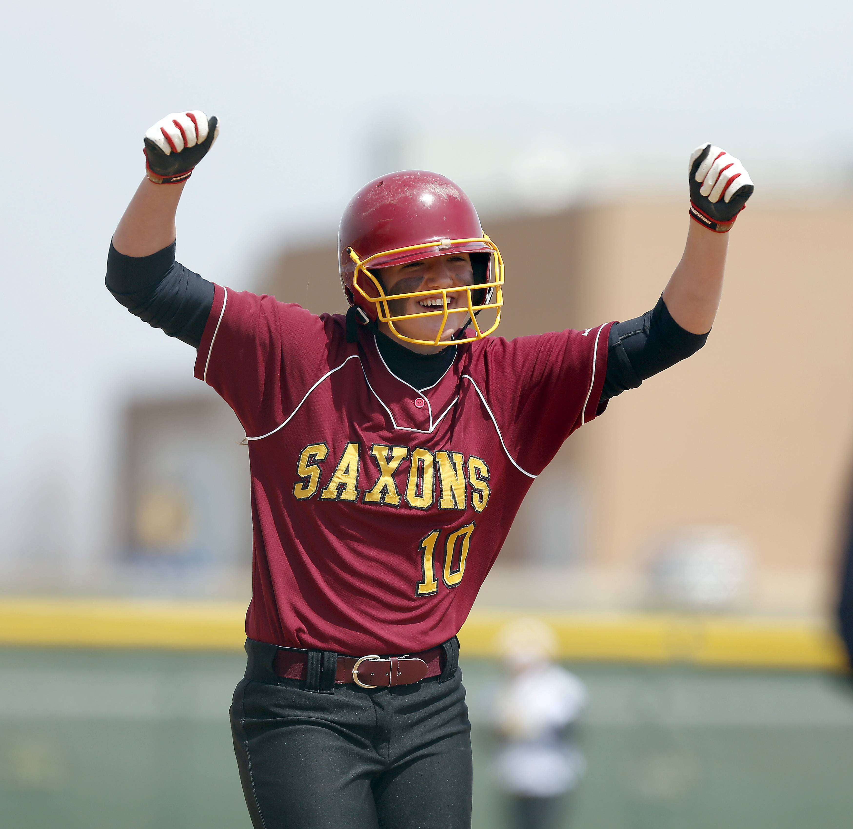 Schaumburg's Paige Alt celebrates her 2-run homer against Jacobs in Algonquin Saturday.