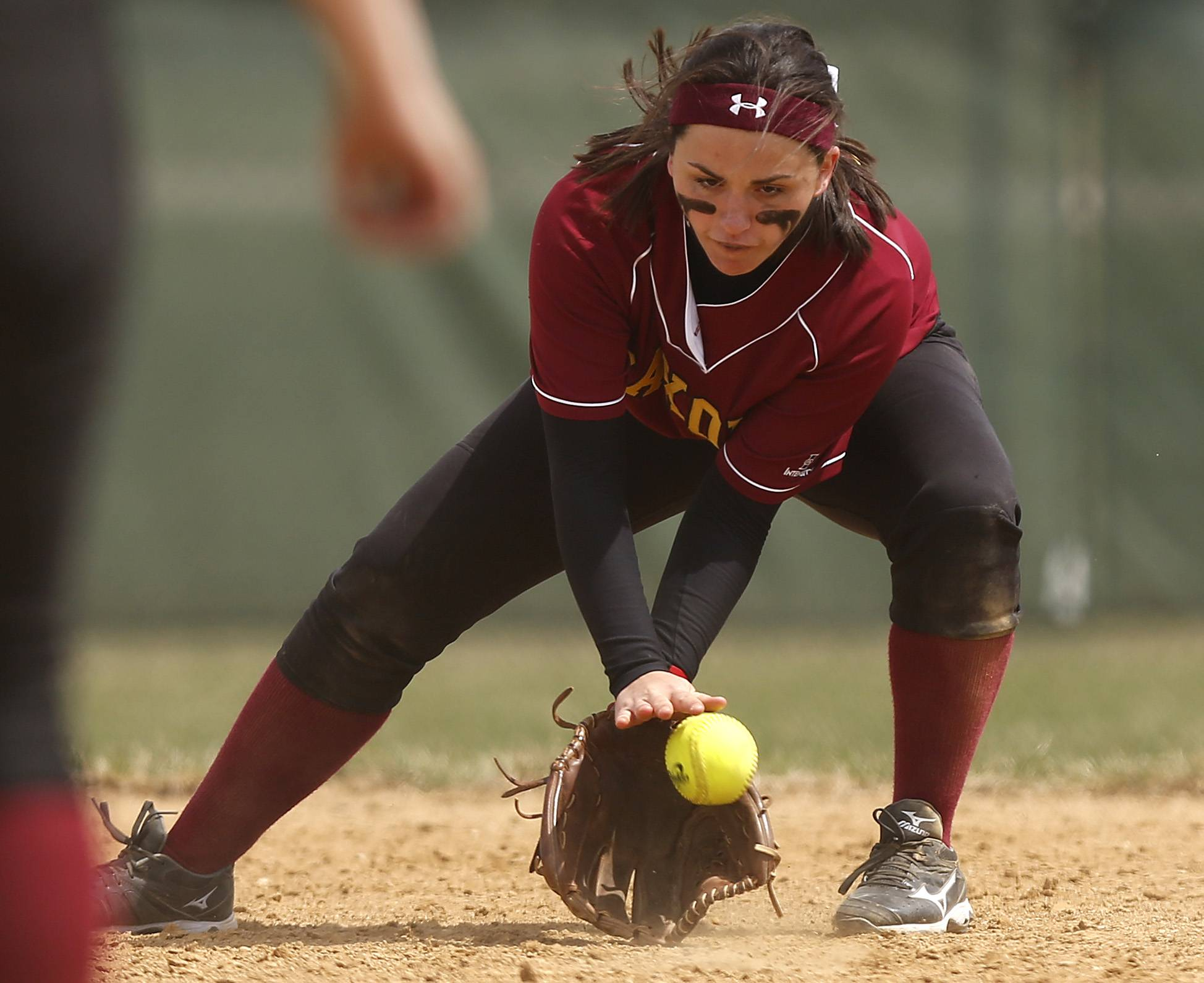 Schaumburg's Natalie Napier pulls in a grounder on Saturday at Jacobs.