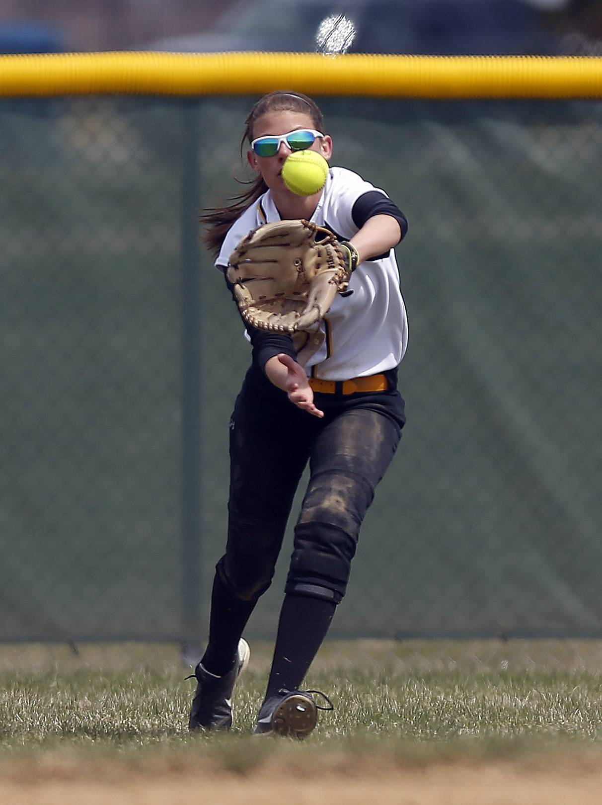 Jacobs outfielder Mackenzie Vaughn reels in a shot by Schaumburg's Christian Candotti on Saturday in Algonquin.