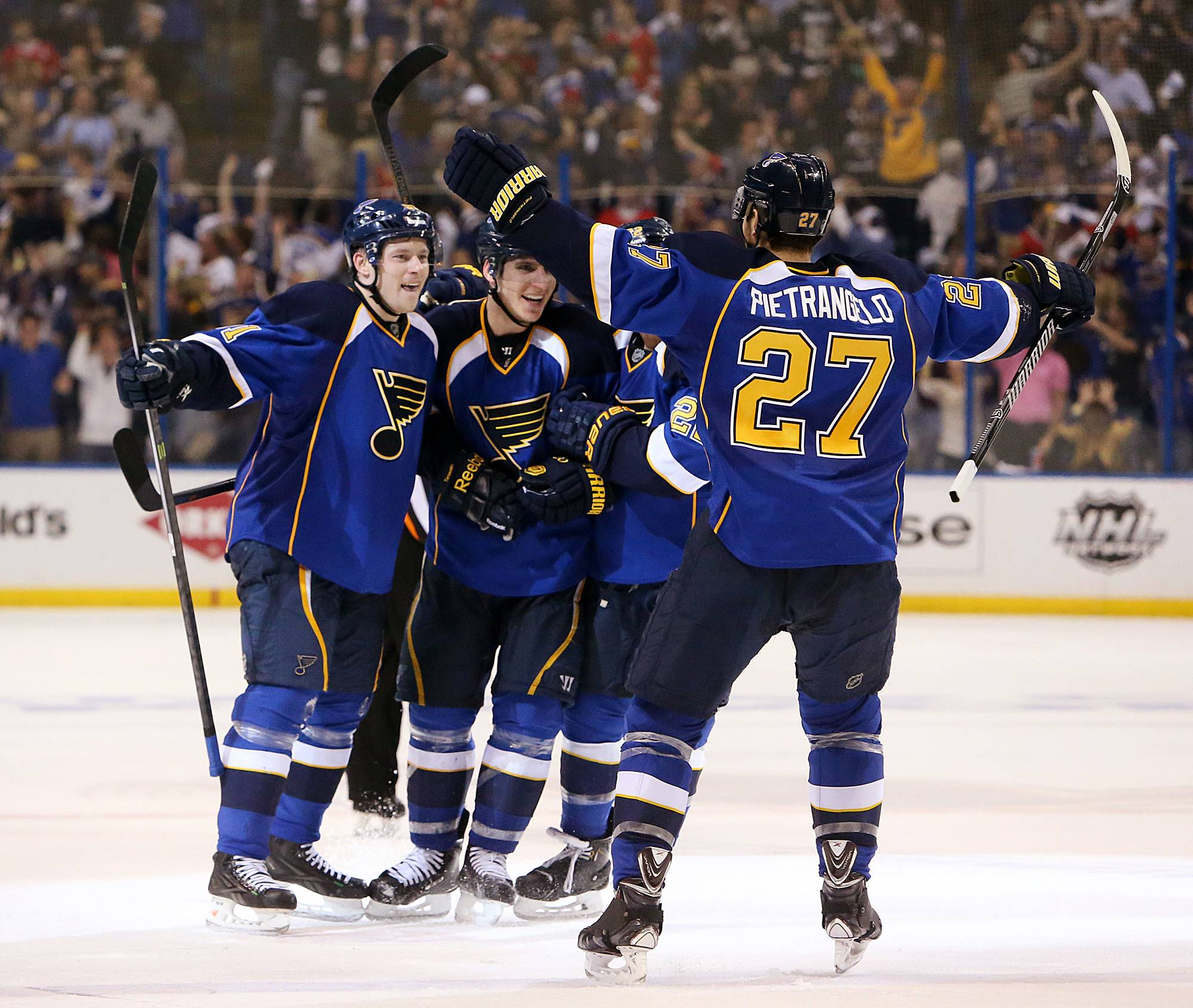 St. Louis Blues right wing Vladimir Tarasenko, left, celebrates with teammates after scoring to tie the game with seconds remaining in regulation during Game 2 of a first-round NHL hockey playoff series against the Chicago Blackhawks, Saturday, April 19, 2014, in St. Louis.