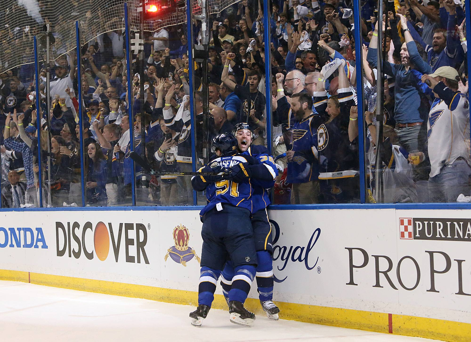 St. Louis Blues left wing Chris Porter, center right, is embraced by teammate Vladimir Tarasenko after scoring the first goal in the first period of Game 2 of a first-round NHL hockey playoff series on Saturday, April 19, 2014, in St. Louis.